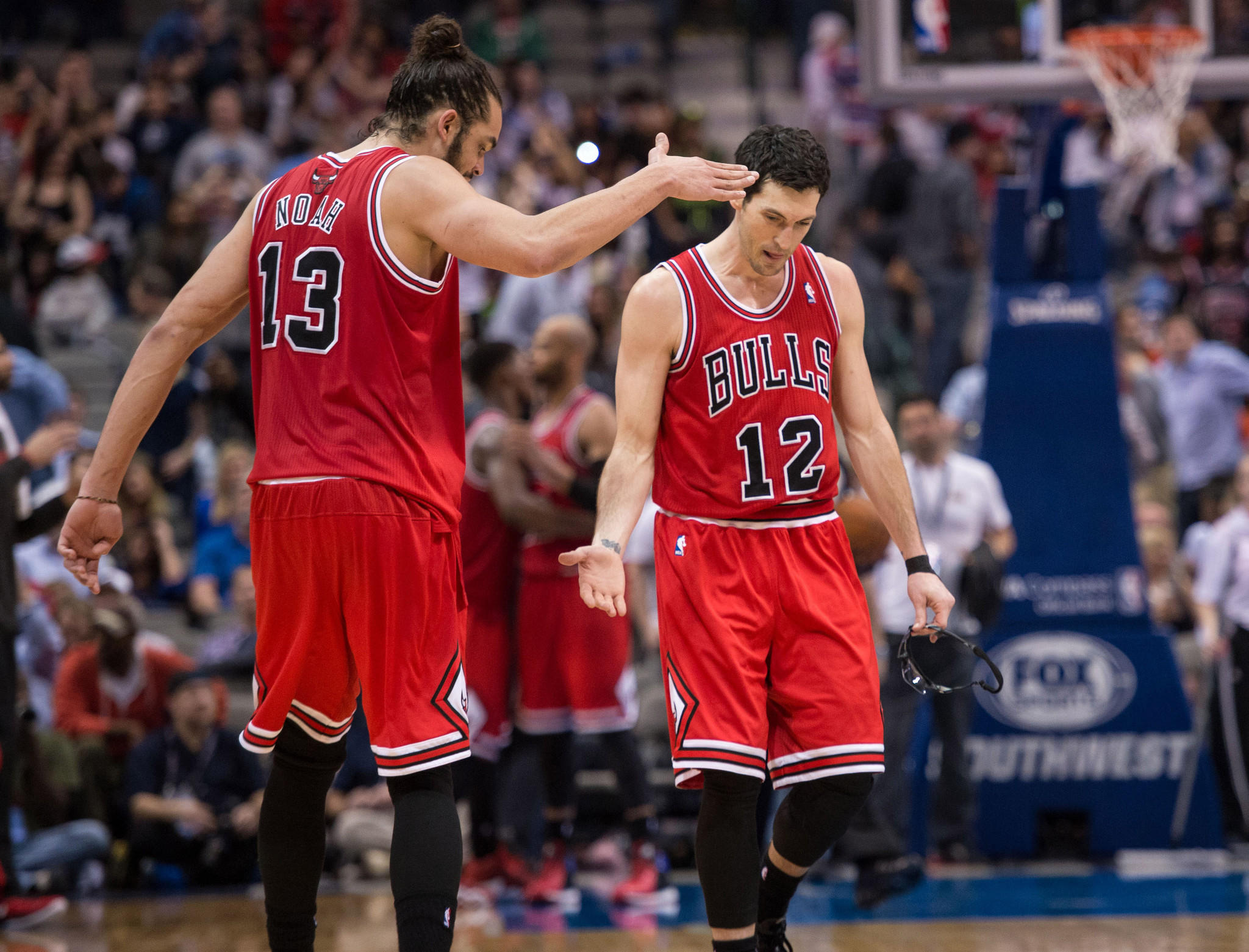 Chicago Bulls center Joakim Noah (13) and shooting guard Kirk Hinrich (12) celebrate the win over the Dallas Mavericks at the American Airlines Center. The Bulls defeated the Mavericks 100-91.