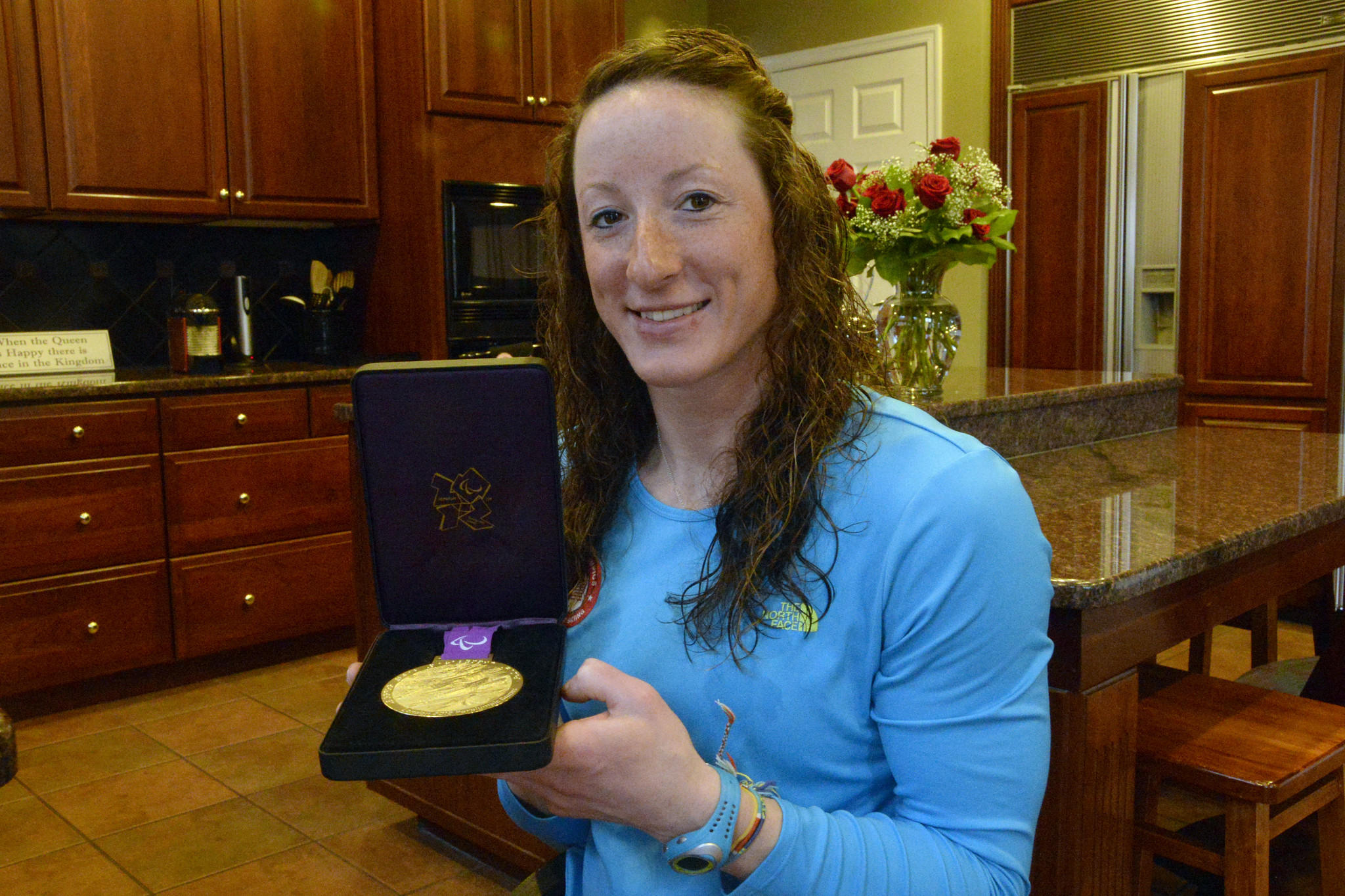Paralympian wheelchair racer Tatyana McFadden, 24, shows off her 2012 London Paralympics gold medal.