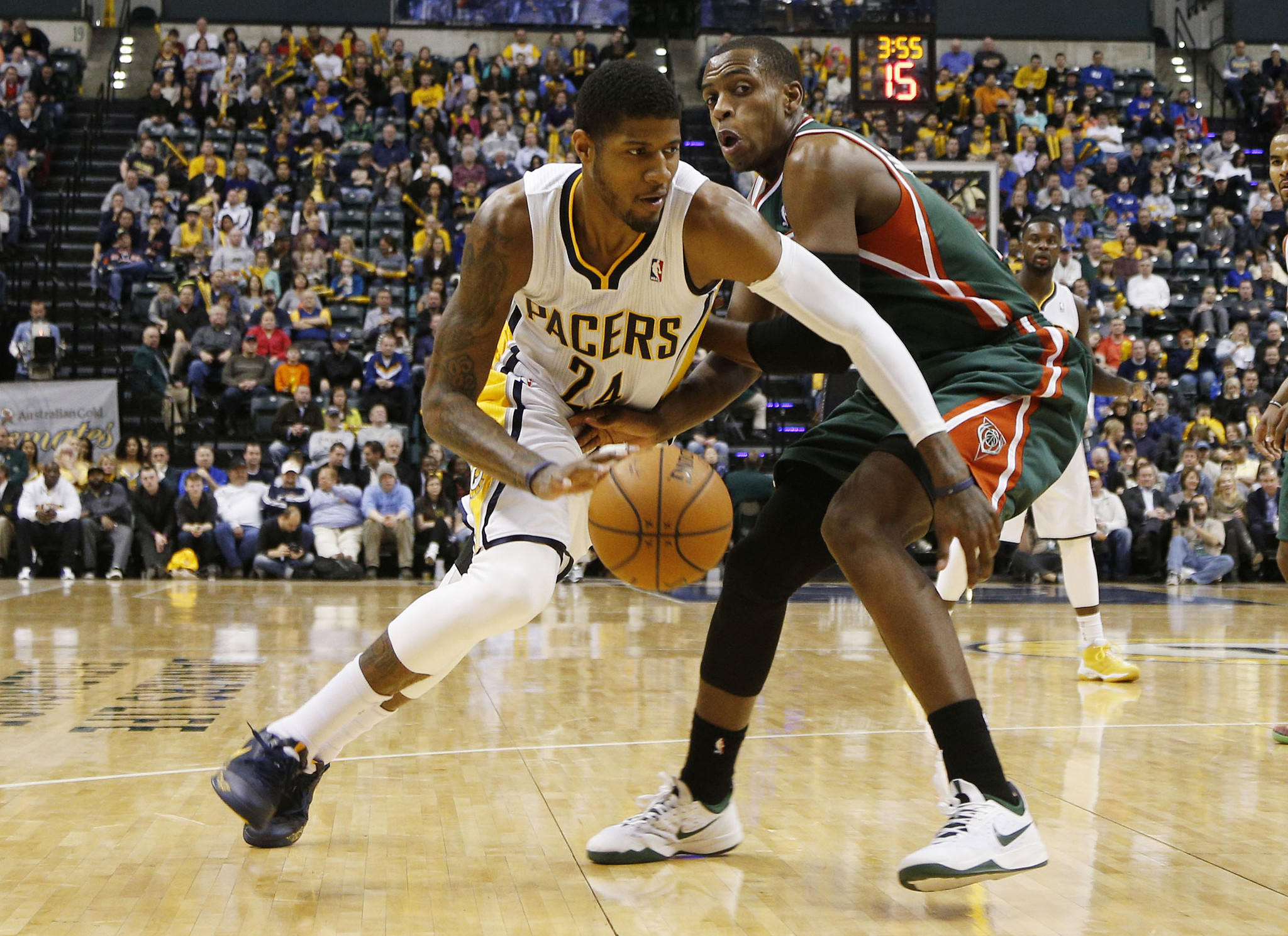 Indiana Pacers forward Paul George (24) dribbles the ball around Milwaukee Bucks forward Khris Middleton (22) at Bankers Life Fieldhouse. The Pacers won 101-96.