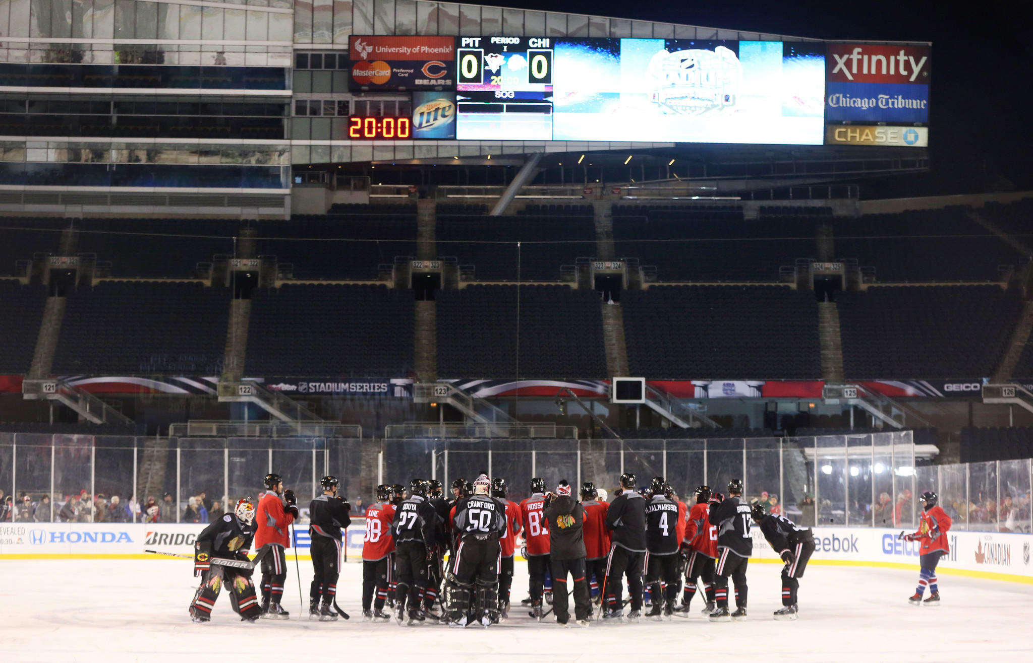 The Chicago Blackhawks come together at center ice during a practice at Soldier Field in Chicago on Friday, February 28, 2014. The Blackhawks will be playing the Pittsburgh Penguins in the NHL's Stadium Series on Saturday.