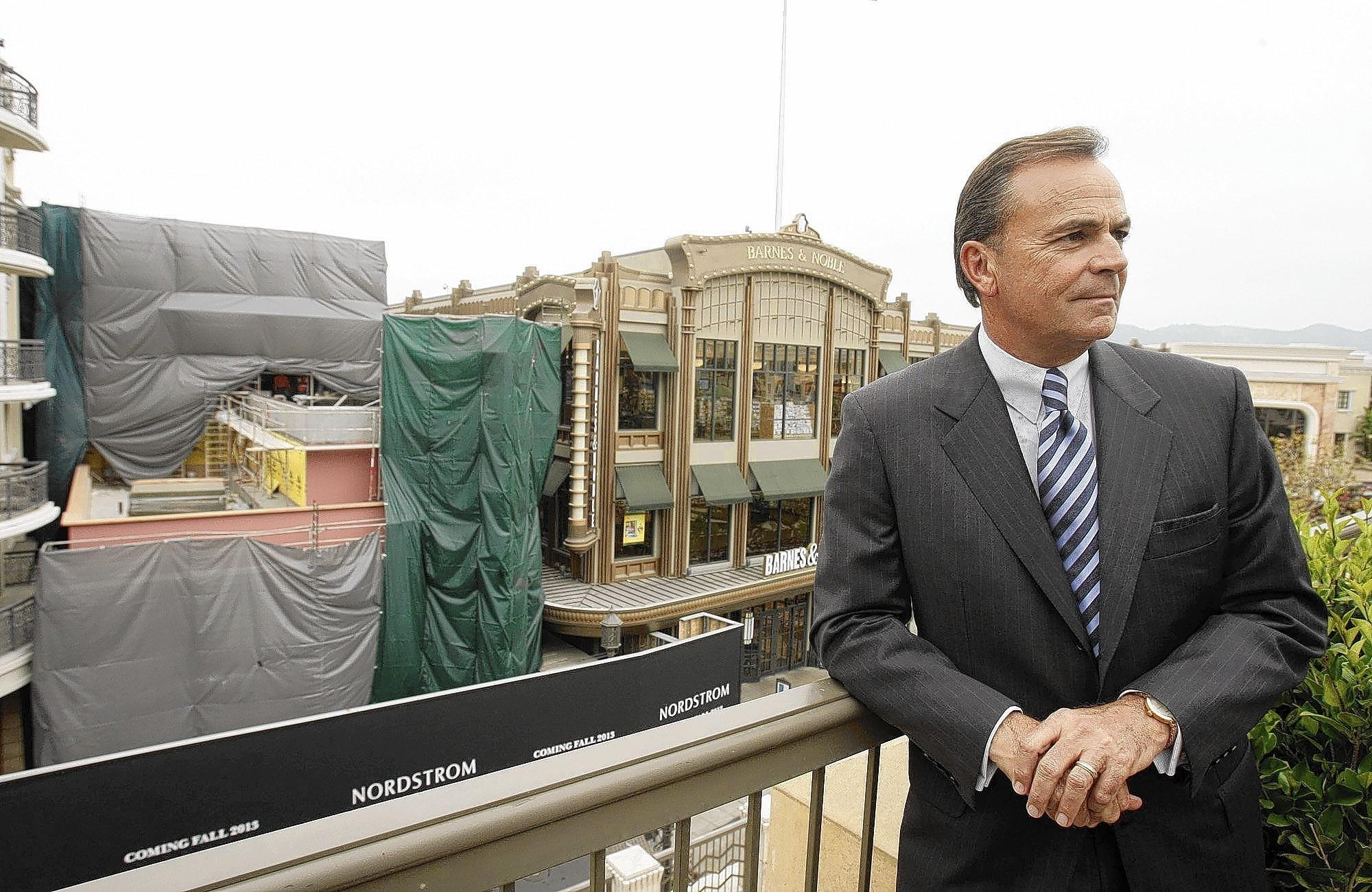 "Rick Caruso, shown last spring at the Americana at Brand mall in Glendale, says he supports a minimum wage hike in L.A. ""Some of the costs will get absorbed by the businesses and some will get passed through to the consumer,"" he said. ""But I think it's good for business in the long run."""