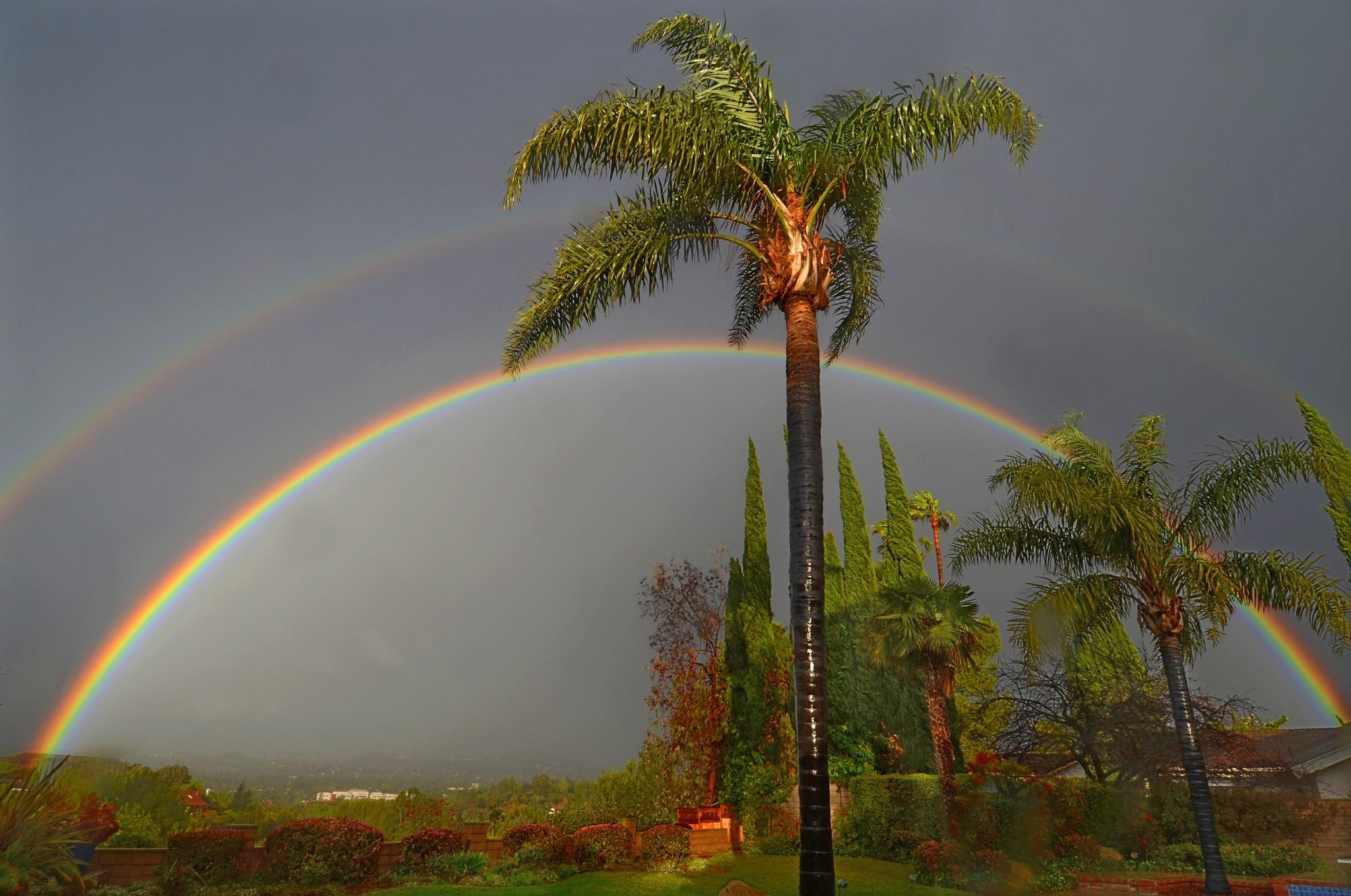In a brief flash of sunlight between rainfalls, a double rainbow appears over Thousand Oaks.