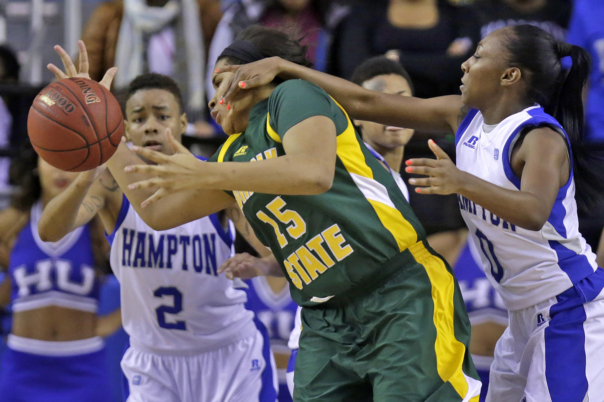 Hampton's Malia Tate-DeFreitas, right, battles for a loose ball with Norfolk State's Logan Powell on Saturday in Hampton.