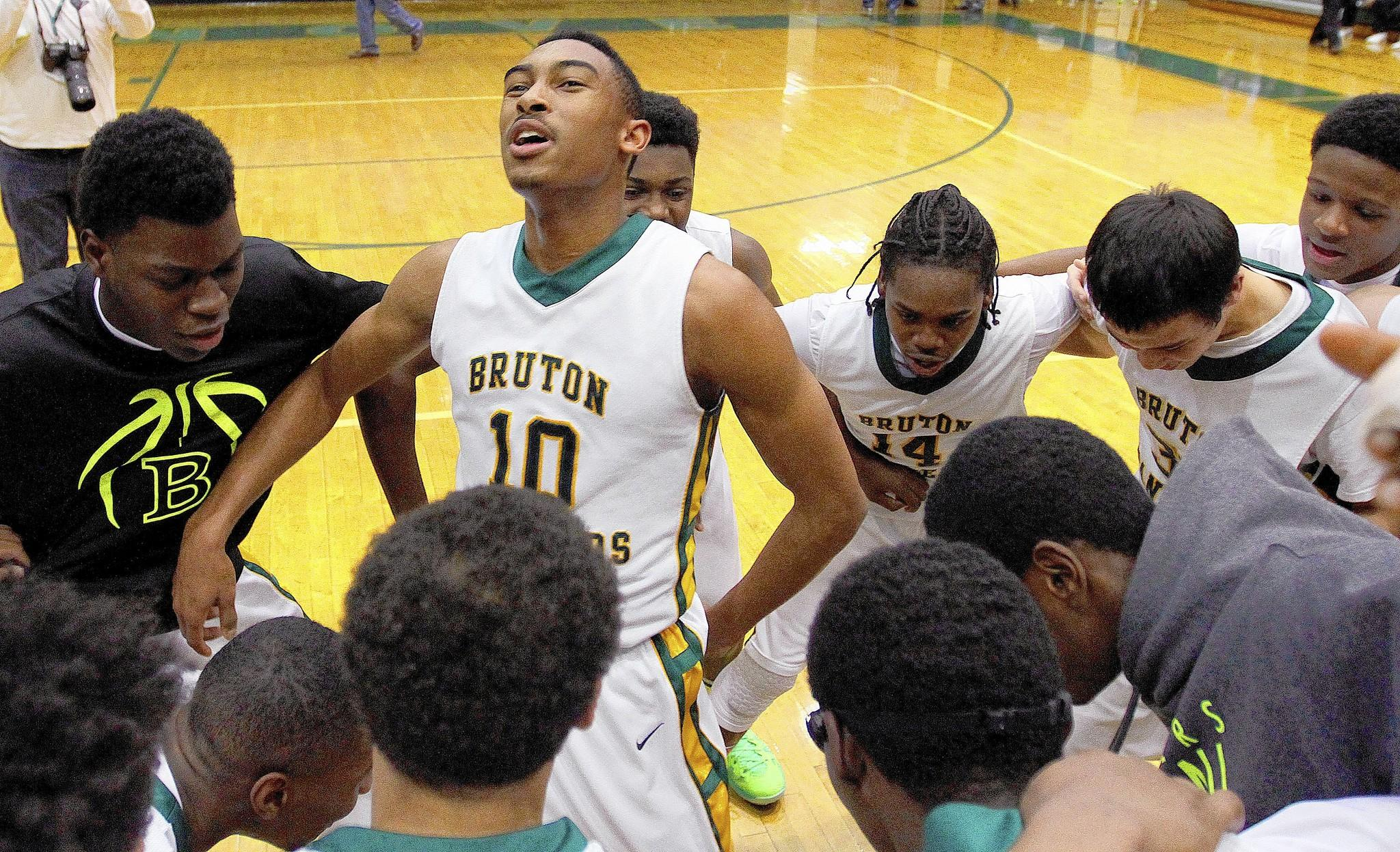 Marcus Carter celebrates with teammates after they beat Prince Edward County in overtime on Saturday in Hanover.
