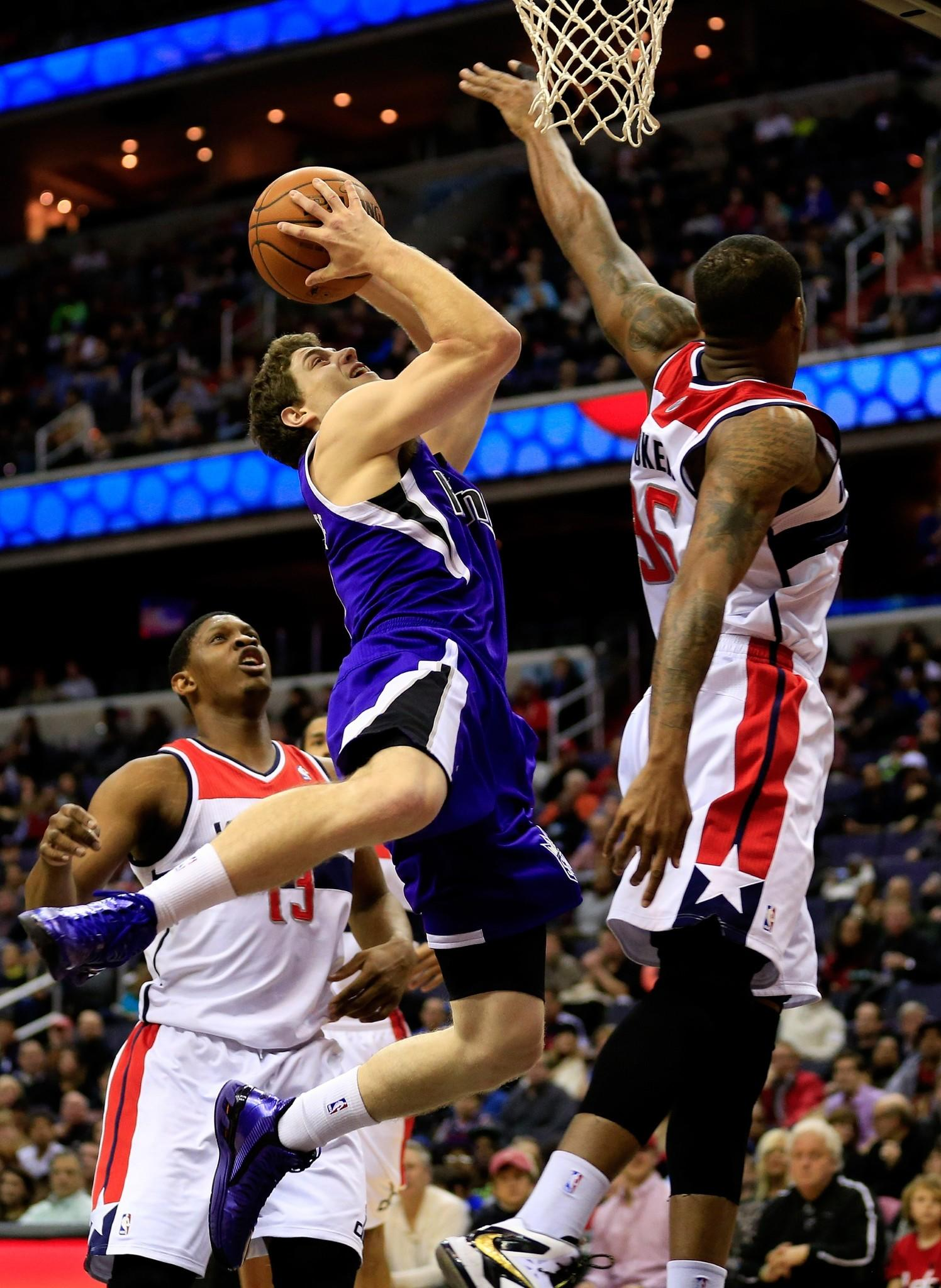 Jimmer Fredette (7) of the Sacramento Kings puts up a shot in front of Trevor Booker #35 of the Washington Wizards during the first half at Verizon Center on February 9, 2014 in Washington, DC.
