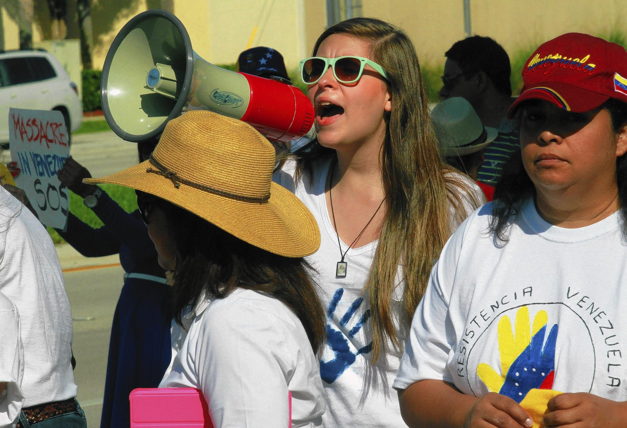 Oriana Bottaro, 15, of Boca Raton, helped organize a rally for fellow Venezuelans on the corner of Glades Road and St. Andrews Avenue near Town Center Mall.