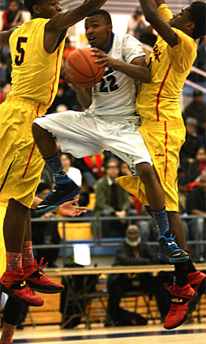 El Camino Real's Maleke Haynes takes on Fairfax's Olisaemeka Nwachie, left, and Lindsey Drew during the Conquistadores' 51-41 victory in the City Section Division I semifinals Saturday at L.A. Southwest College.
