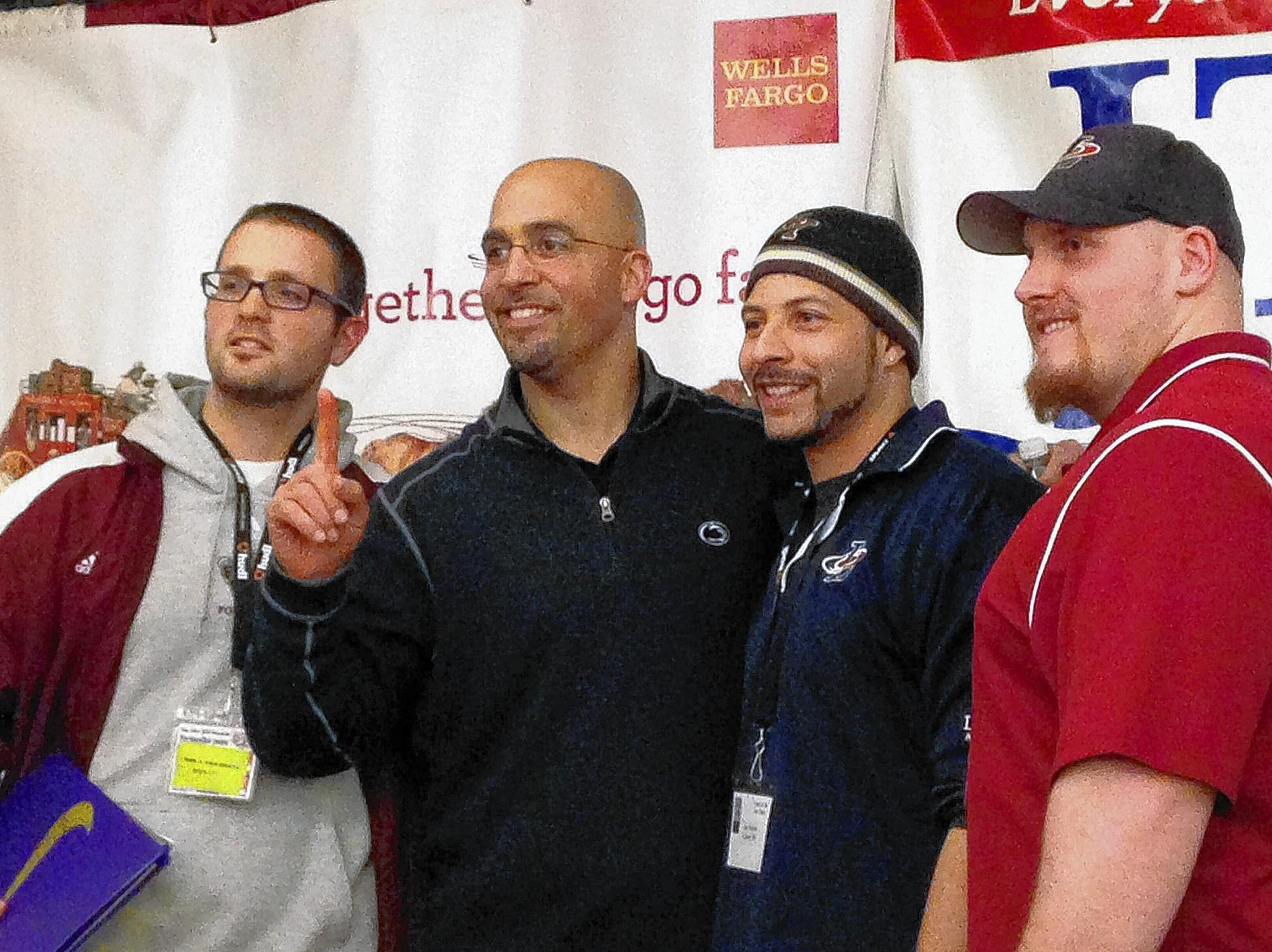 Penn State football coach James Franklin poses with area football coaches at the Nike Coach of the Year clinic Friday at the Holiday Inn Fogelsville.