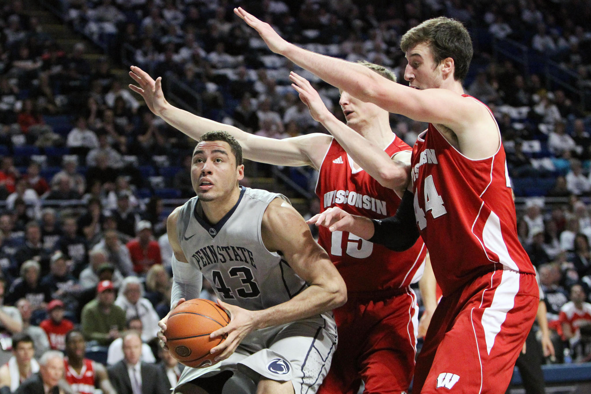 Penn State forward Ross Travis (43) prepares to shoot against the Wisconsin defense.