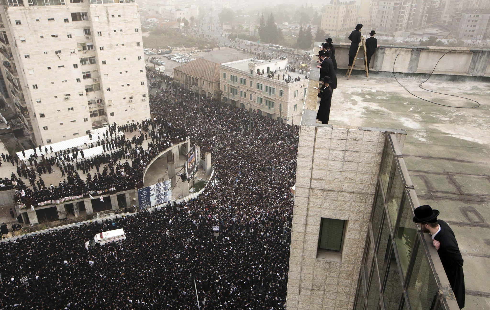 Ultra-Orthodox Jews mass in Jerusalem on Sunday to protest a proposed law that would largely eliminate their exemption to Israel's military draft.