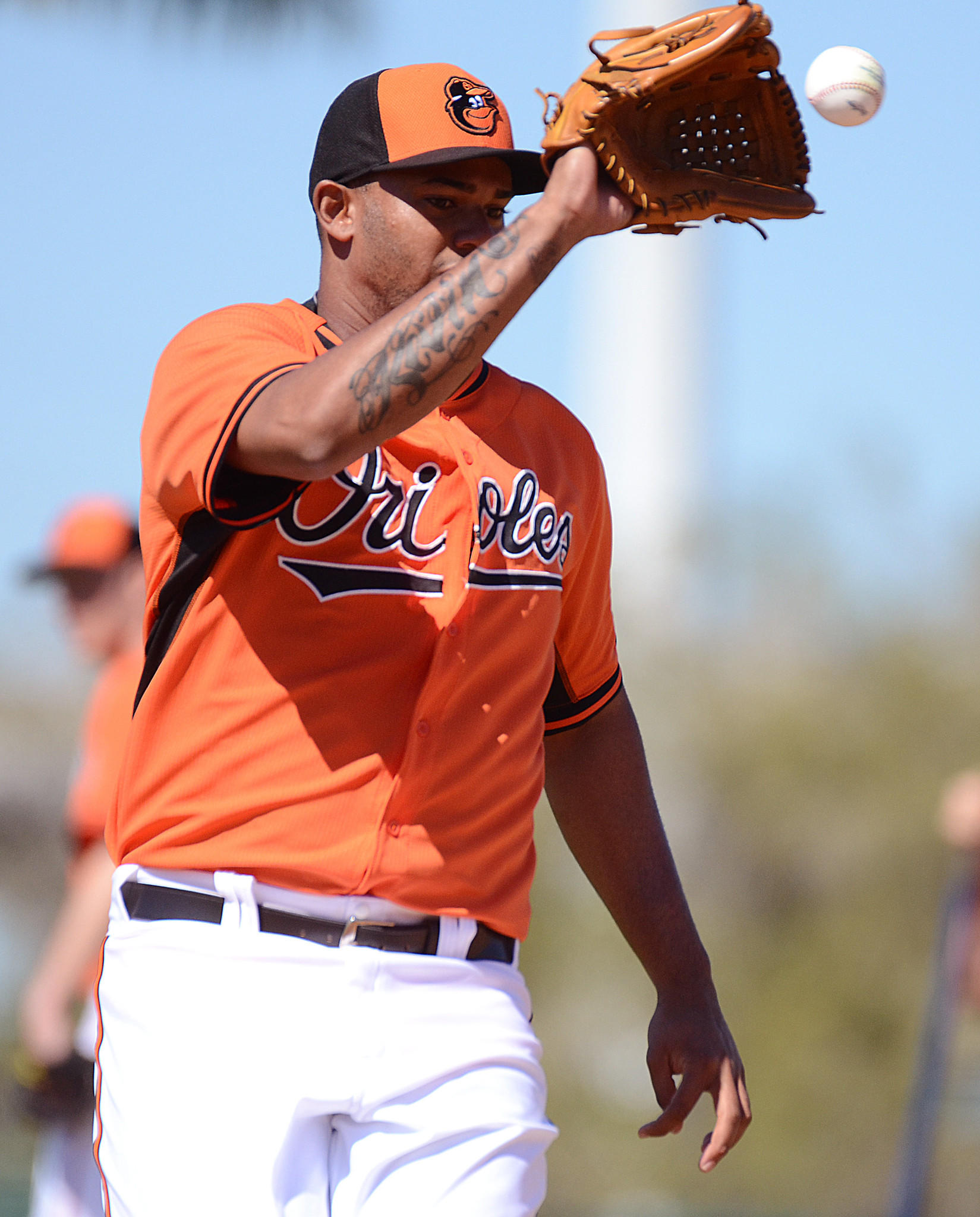 Orioles pitcher Kelvin De La Cruz work on fielding drills on Feb. 14 in Sarasota, Fla.