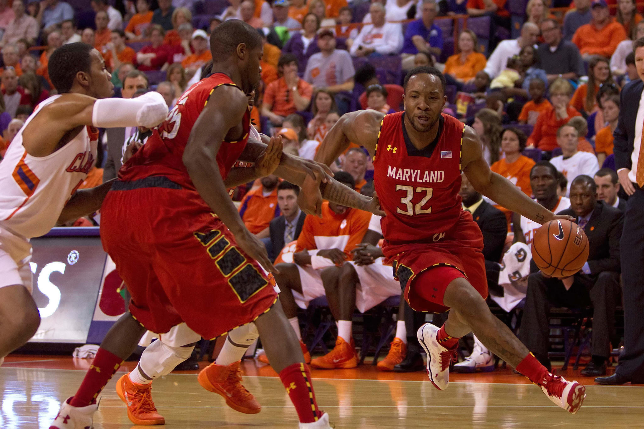 Maryland's Dez Wells dribbles down court against Clemson in the first half.