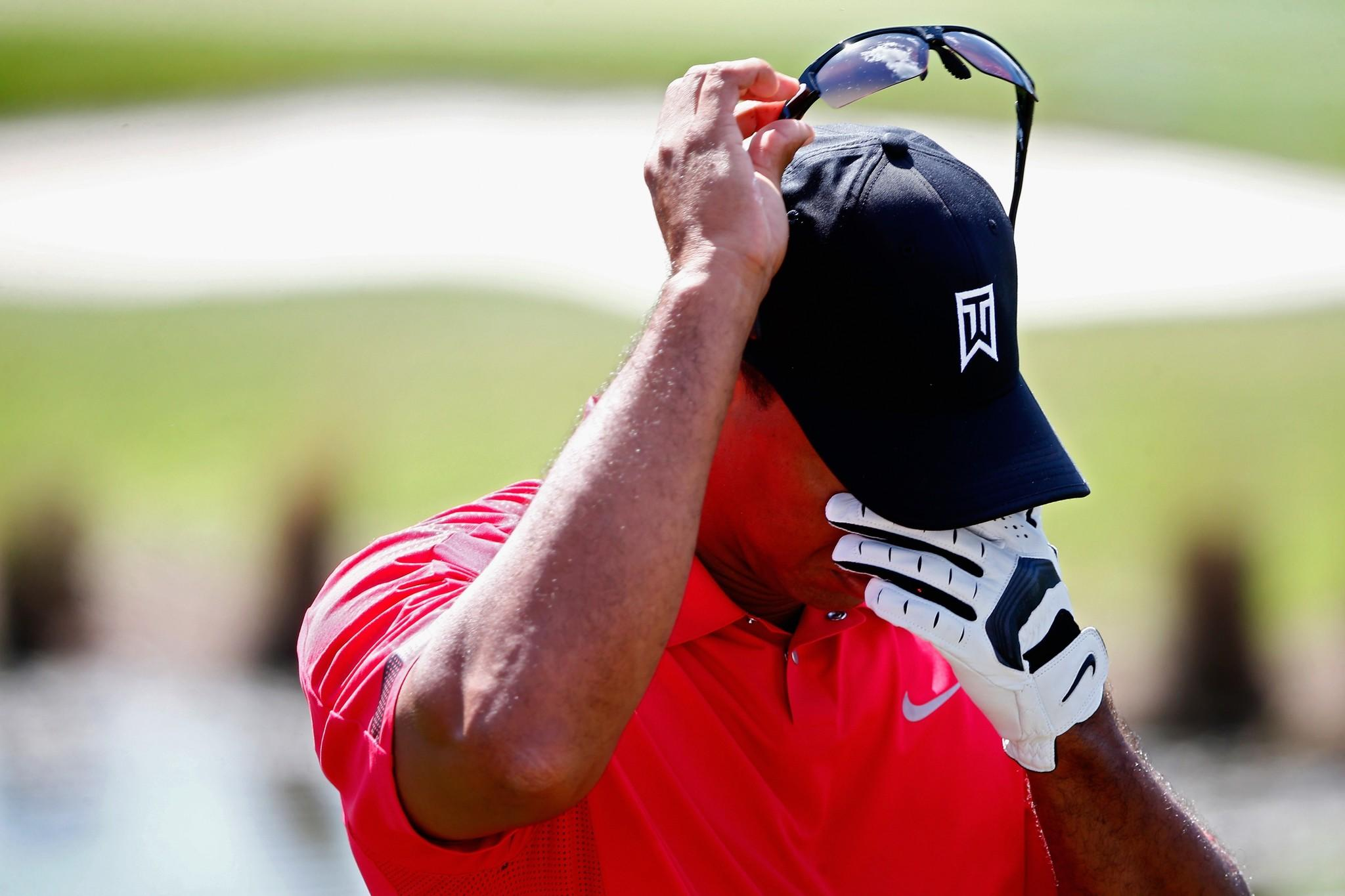 Tiger Woods wipes his face during the final round of The Honda Classic at PGA National Resort and Spa.