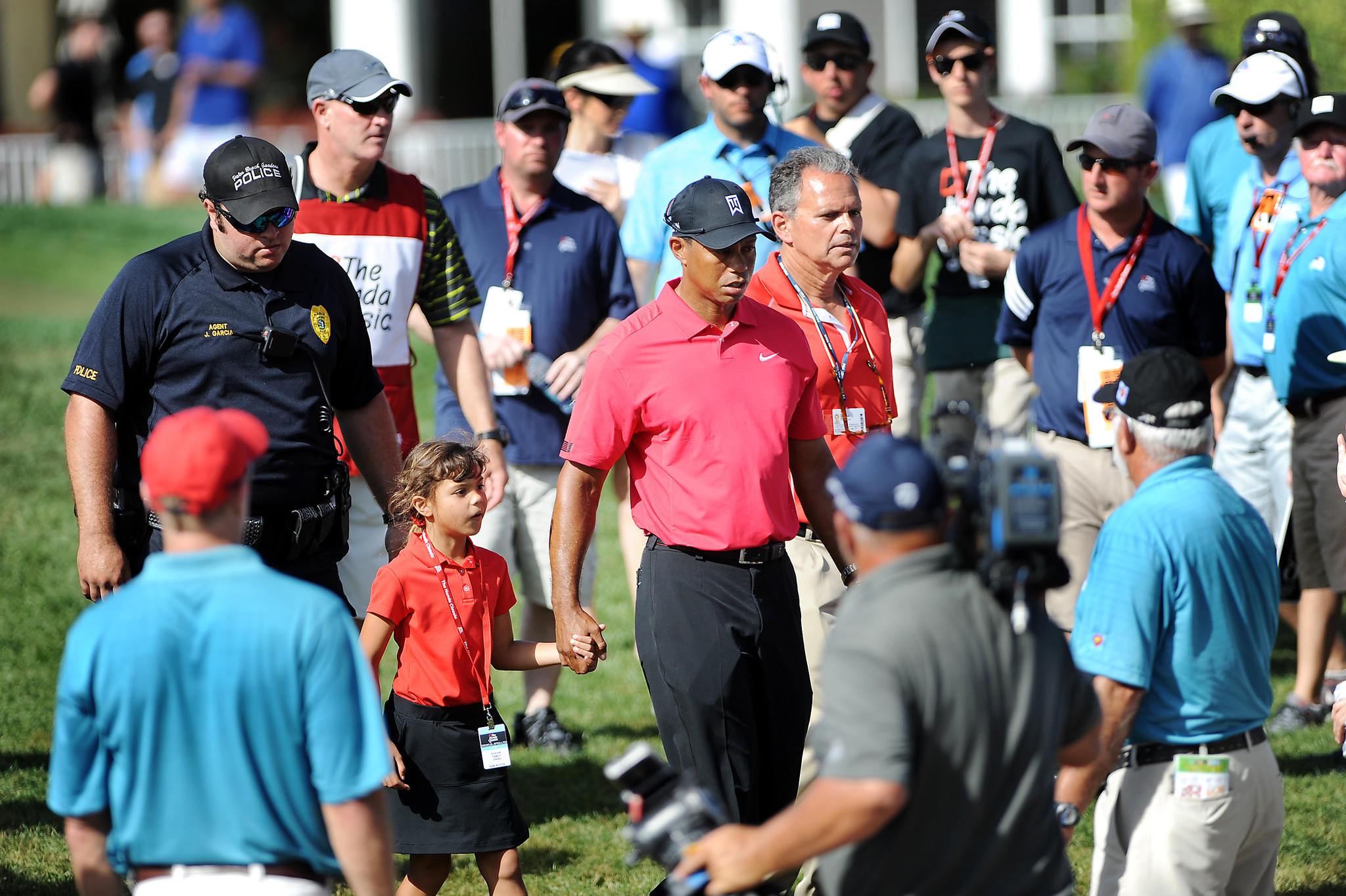Tiger Woods walks off the 13th green Sunday afternoon at The Honda Classic in Palm Beach Gardens. He withdrew from the tournament after complaining of back pain.
