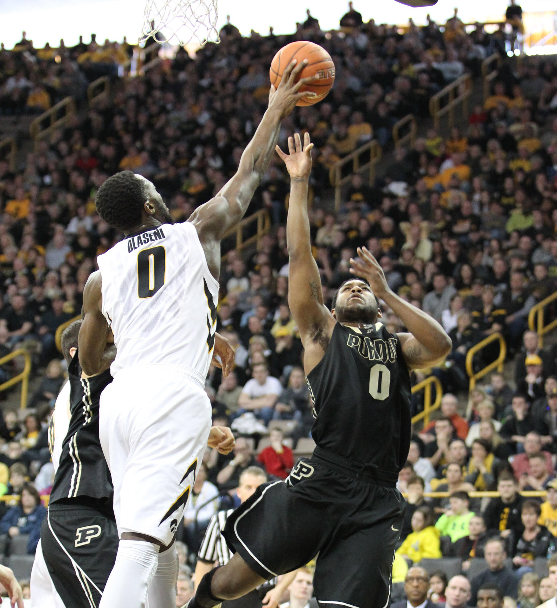 Iowa's Gabriel Olaseni blocks the shot of Purdue's Terone Johnson during the first half.