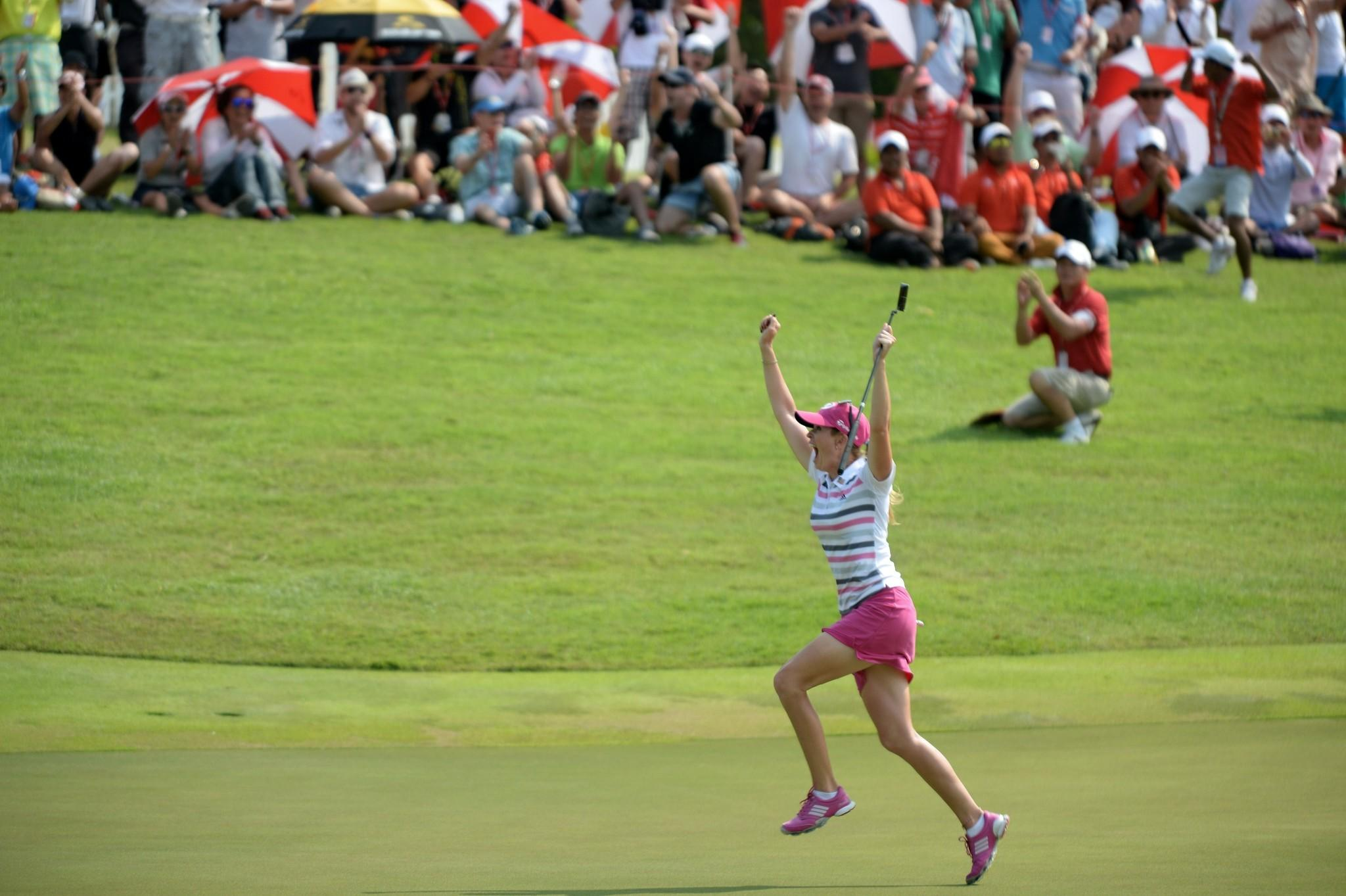 Paula Creamer reacts after winning the final round of the 2014 HSBC Women's Champions golf tournament in Singapore.