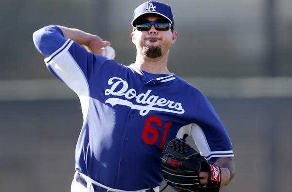Josh Beckett, loosening up during a workout last month, made his debut Sunday, pitching for the first time in a game since May 13 of last season.