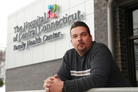 Sean Currry is photographed in front of The Hospital of Central Connecticut Family Health Center in Bristol.