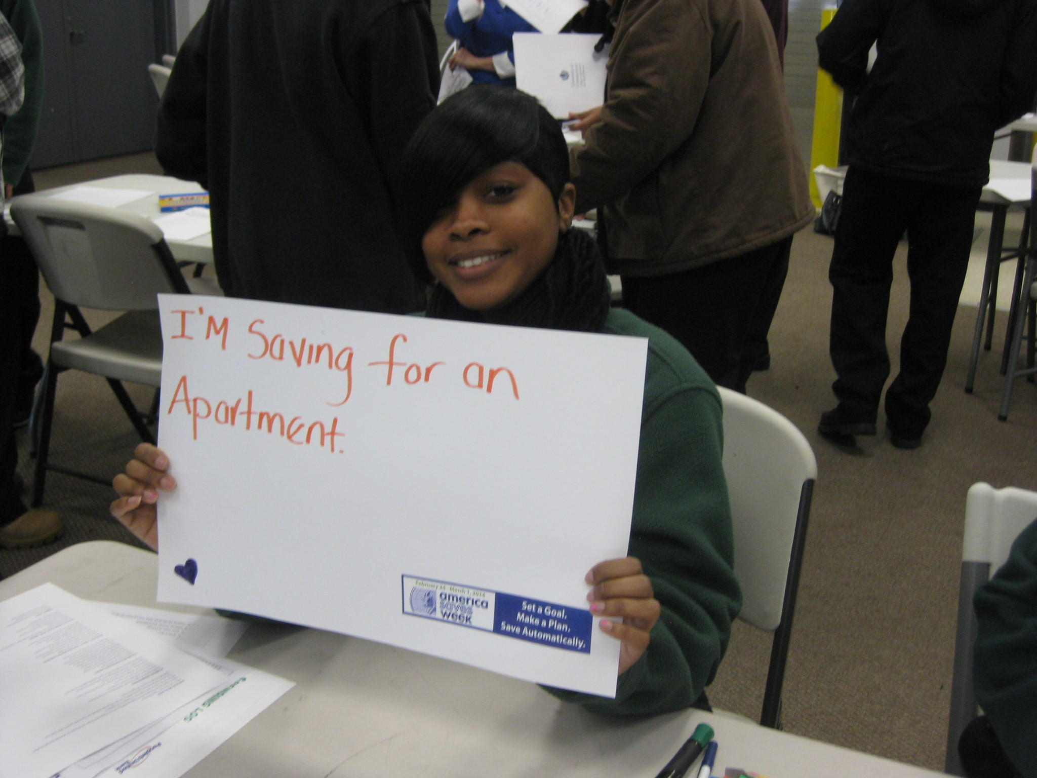 Hartford Job Corps student illustrates what she is saving for during America Saves Week event.