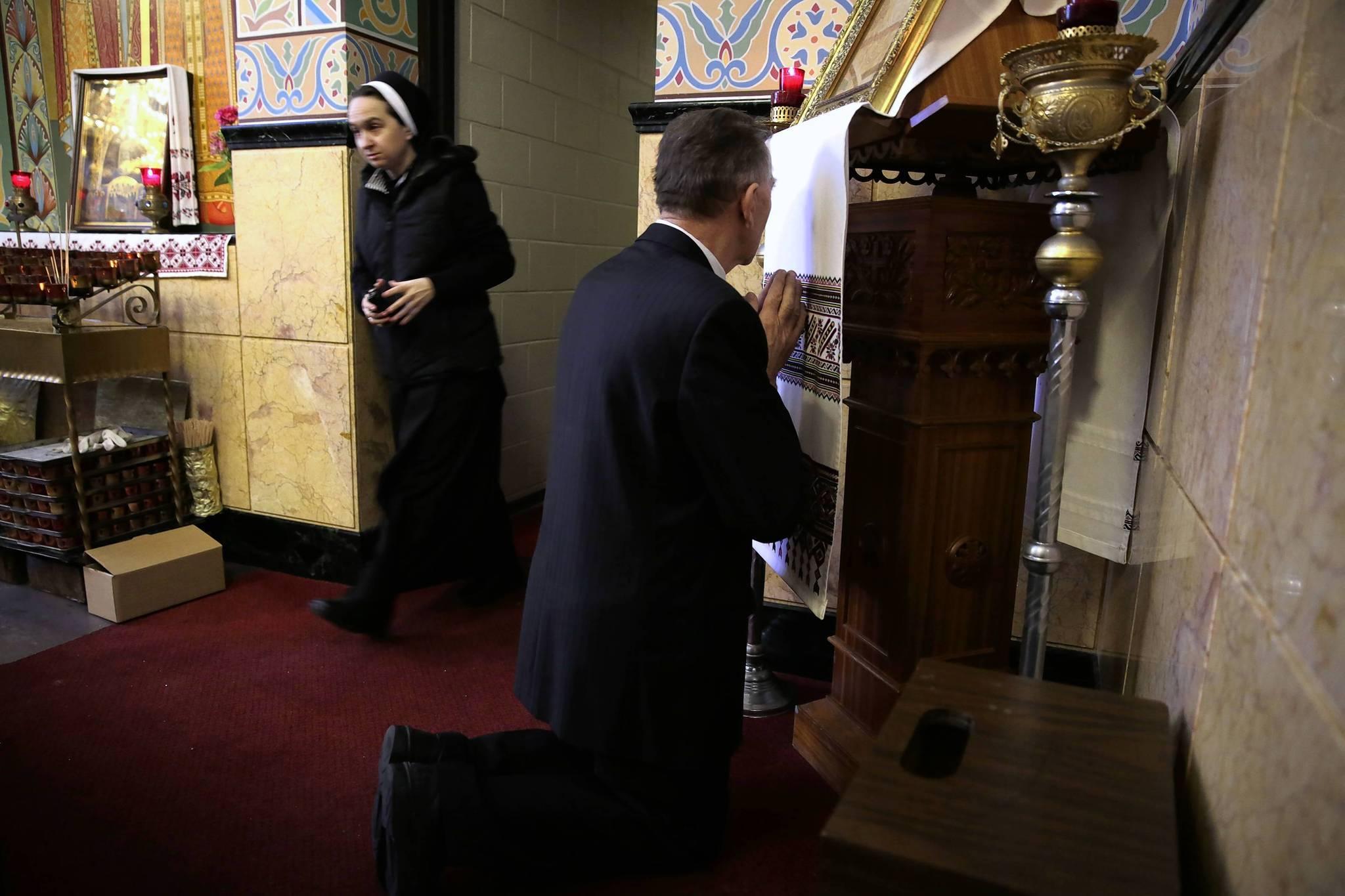 Lyubomyr Dmyterko, of Chicago, prays after mass at Sts. Volodymyr and Olha Ukrainian Catholic Church in Chicago on Sunday.