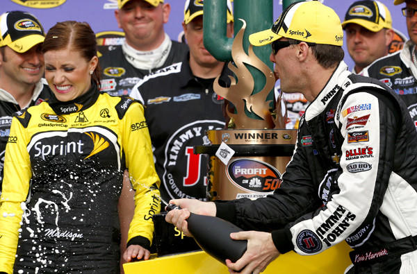 Kevin Harvick celebrates in Victory Lane after winning the NASCAR Sprint Cup Series race on Sunday at Phoenix International Raceway.