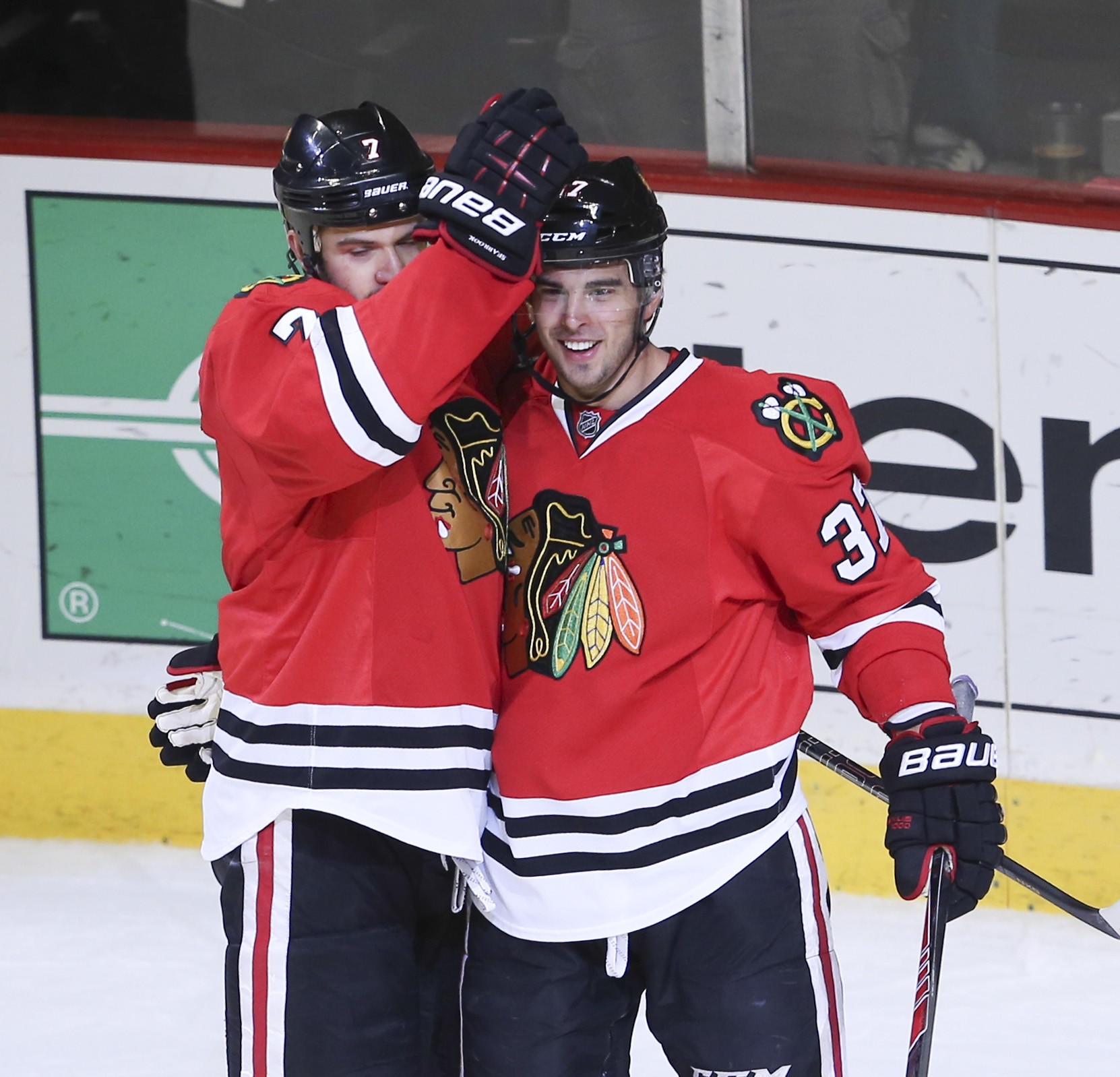 Brandon Pirri (37) celebrates his goal with Brent Seabrook against the Maple Leafs.