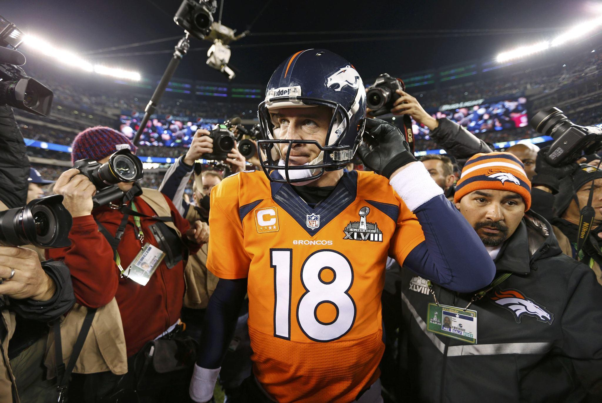 Broncos quarterback Peyton Manning leaves field after being defeated by the Seahawks in Super Bowl XLVIII.
