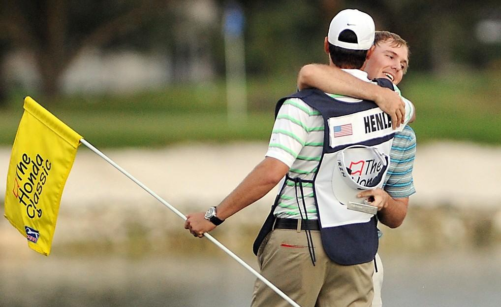 Russell Henley hugs his caddie after his Honda Classic playoff win over Russell Knox, Ryan Palmer and Rory MCilroy.