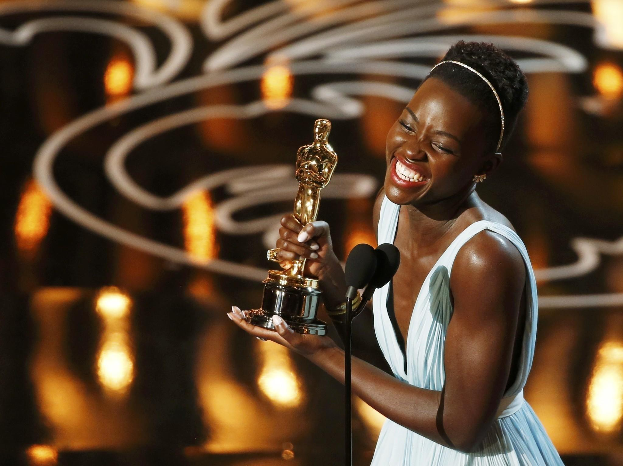 "Lupita Nyong'o, best supporting actress winner for her role in ""12 Years a Slave"", speaks on stage at the 86th Academy Awards in Hollywood."