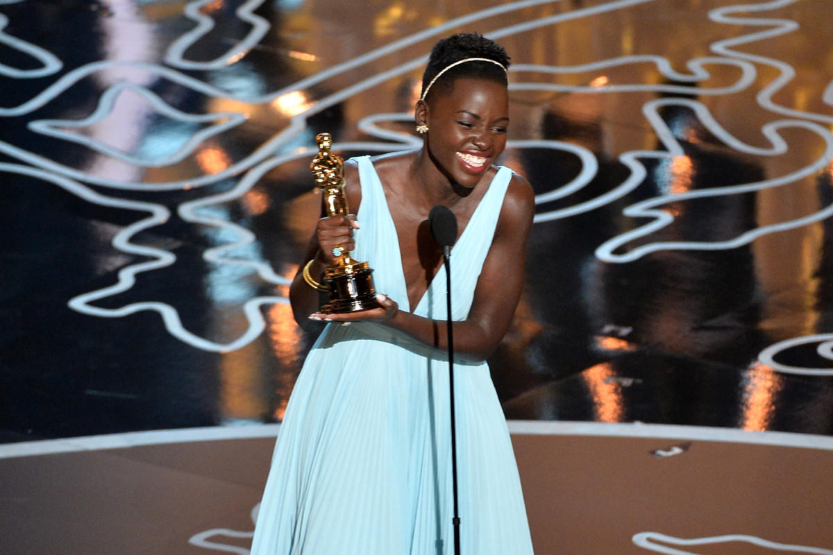 "Actress Lupita Nyong'o accepts the Oscar for supporting actress for her role in ""12 Years a Slave."""