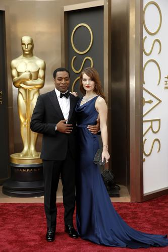 Chiwetel Ejiofor (pictured with Sari Mercer) has a sister, Zain Asher, who works for CNN and took time to record a special message for her brother. E! News played the message for the lead actor nominee Ejiofor, who seemed visibly moved by watching the video live on the red carpet.