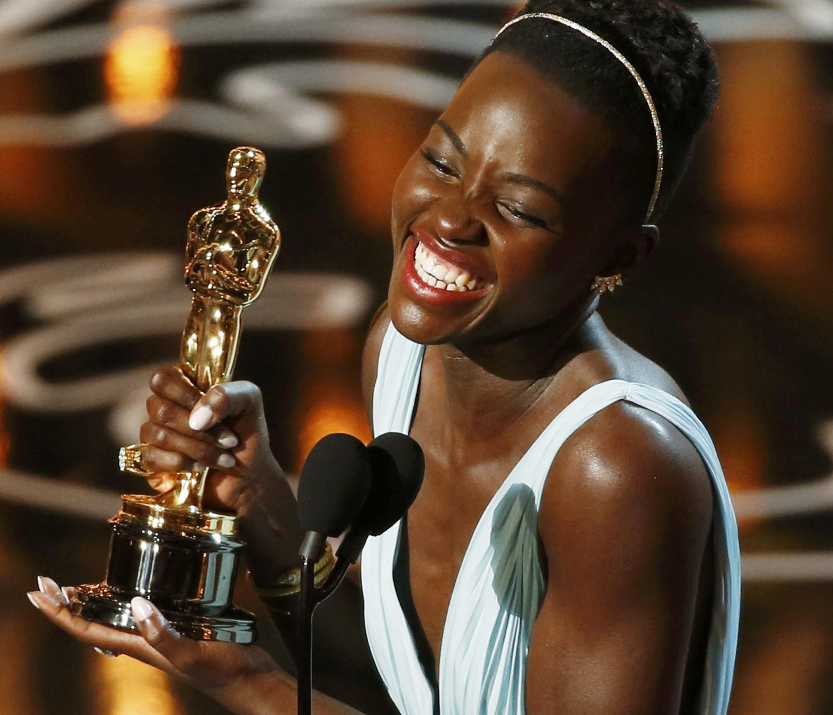 "Lupita Nyong'o accepts her best supporting actress Oscar for her role in ""12 Years a Slave"" at the 86th Academy Awards in Hollywood."