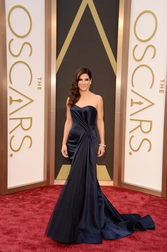 Wearing Alexander McQueen, Sandra Bullock solidifies 2014 as her best year ever for red-carpet fashion, reportedly because of a new stylist.
