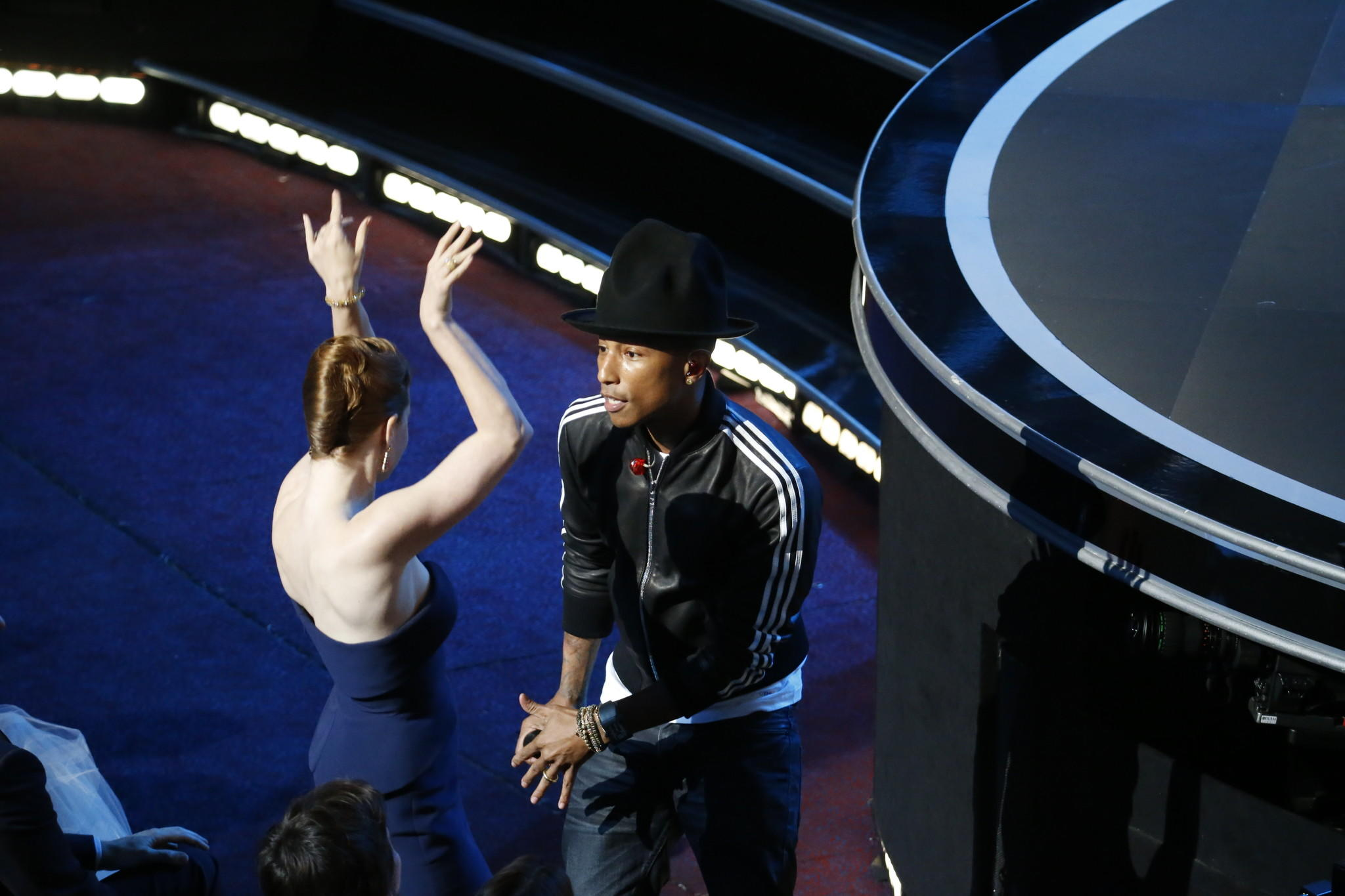 "Pharrell Williams, dancing with Amy Adams as he works the crowd, sings ""Happy"" from ""Despicable Me 2."""
