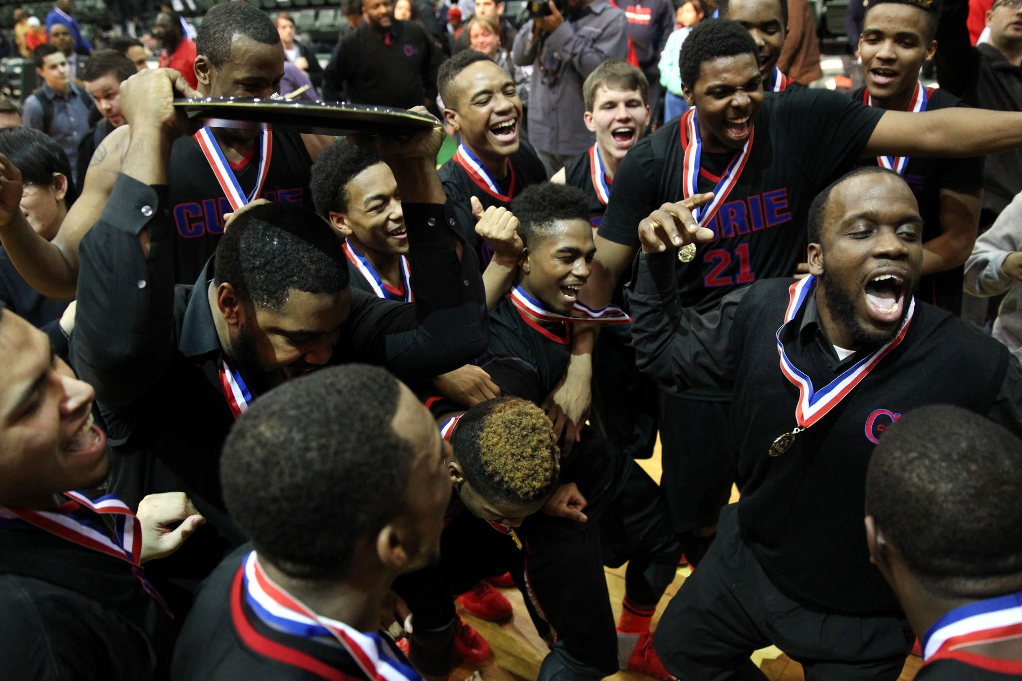 Curie celebrates their victory over Whitney Young in the Public League playoff final at Chicago State.