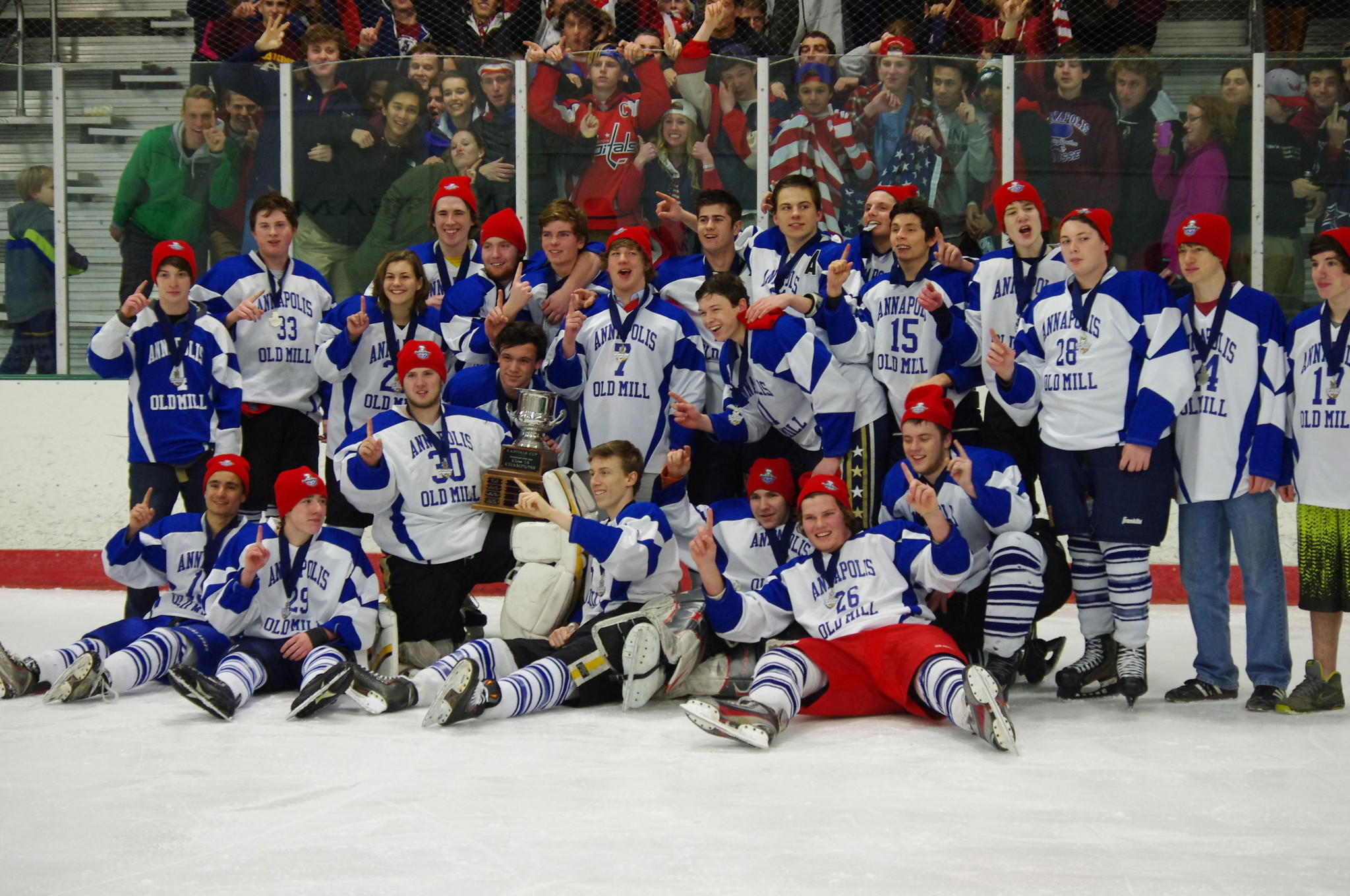 Members of the Annapolis Old Mill hockey team celebrate the team's win over Washington County Northstars, 5-1, capturing the Maryland Scholastic Hockey League Class 1A Ice Hockey Championship on Friday at the Garden's Ice House in Laurel.