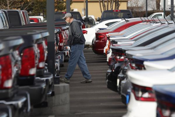 A shopper heads to the pickup trucks at a Chrysler dealership in Littleton, Colo. Auto sales rose only slightly in February.