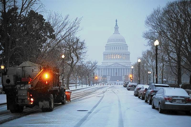 A general view of the U.S. Capitol in early morning snow in Washington.