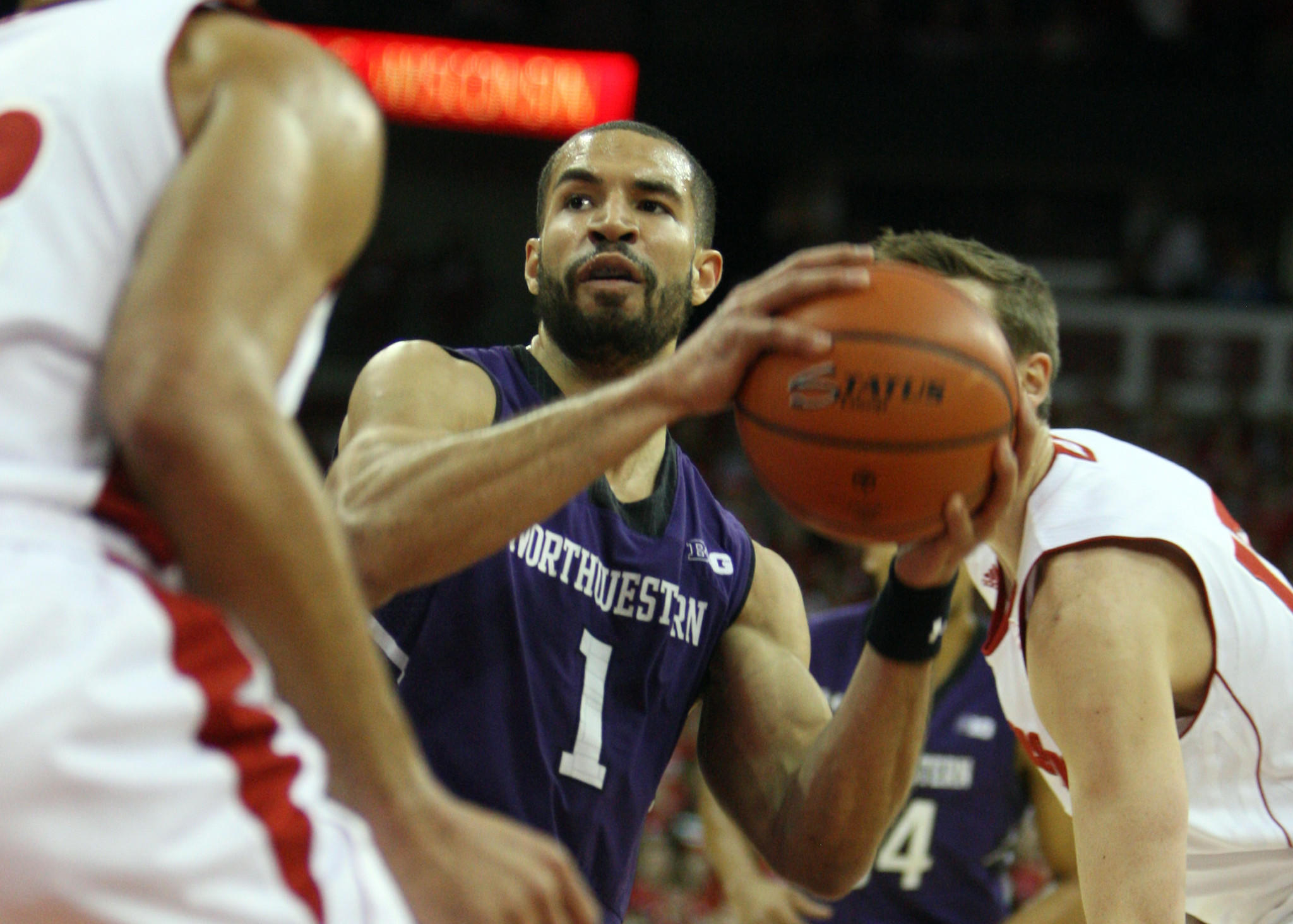 Northwestern guard Drew Crawford looks to pass against Wisconsin.