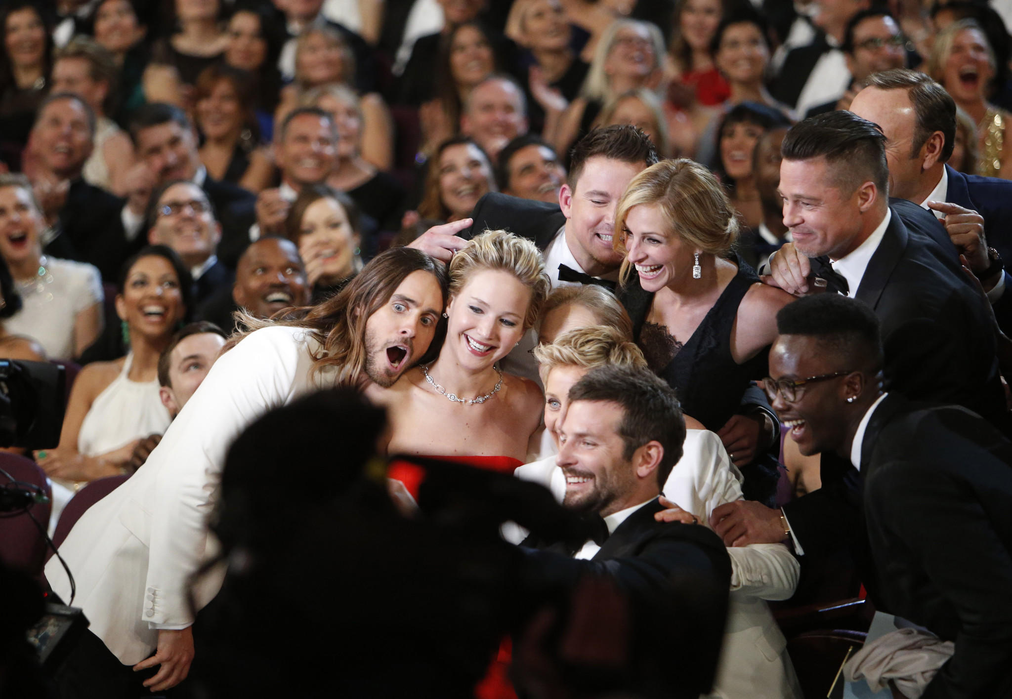 Ellen DeGeneres gathers members from the audience for a selfie, from backstage at the 86th Annual Academy Awards on Sunday at the Dolby Theatre at Hollywood & Highland Center in Hollywood.