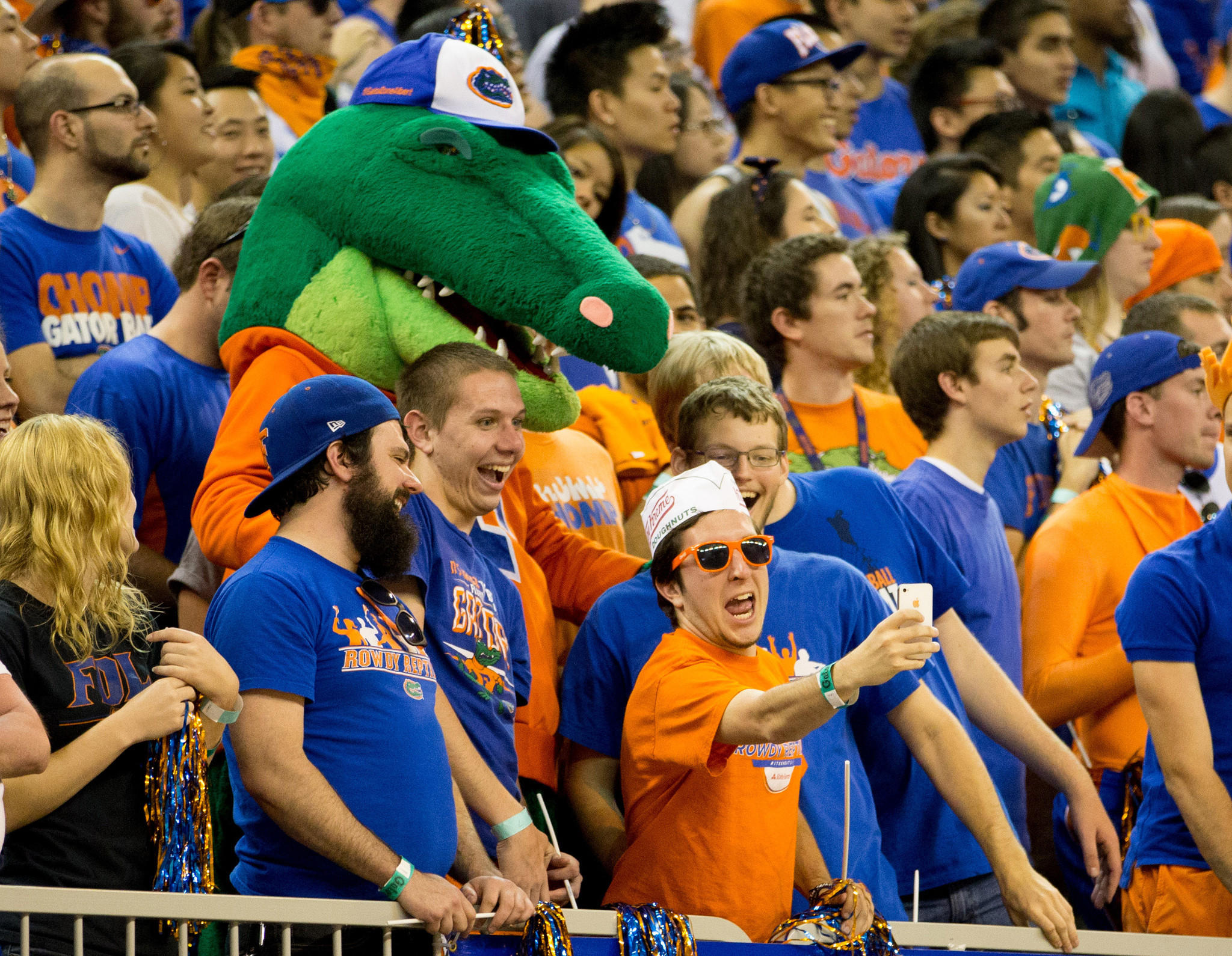 Florida Gators fans take a selfie with Albert the mascot during the second half of the game against the LSU Tigers at the Stephen C. O'Connell Center.