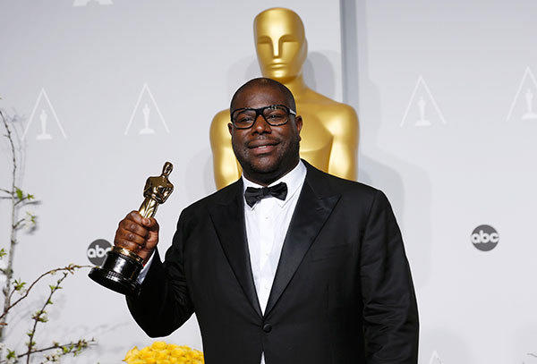 """""""12 Years a Slave"""" director Steve McQueen poses with his best picture award at the 86th Academy Awards in Hollywood on March 2."""