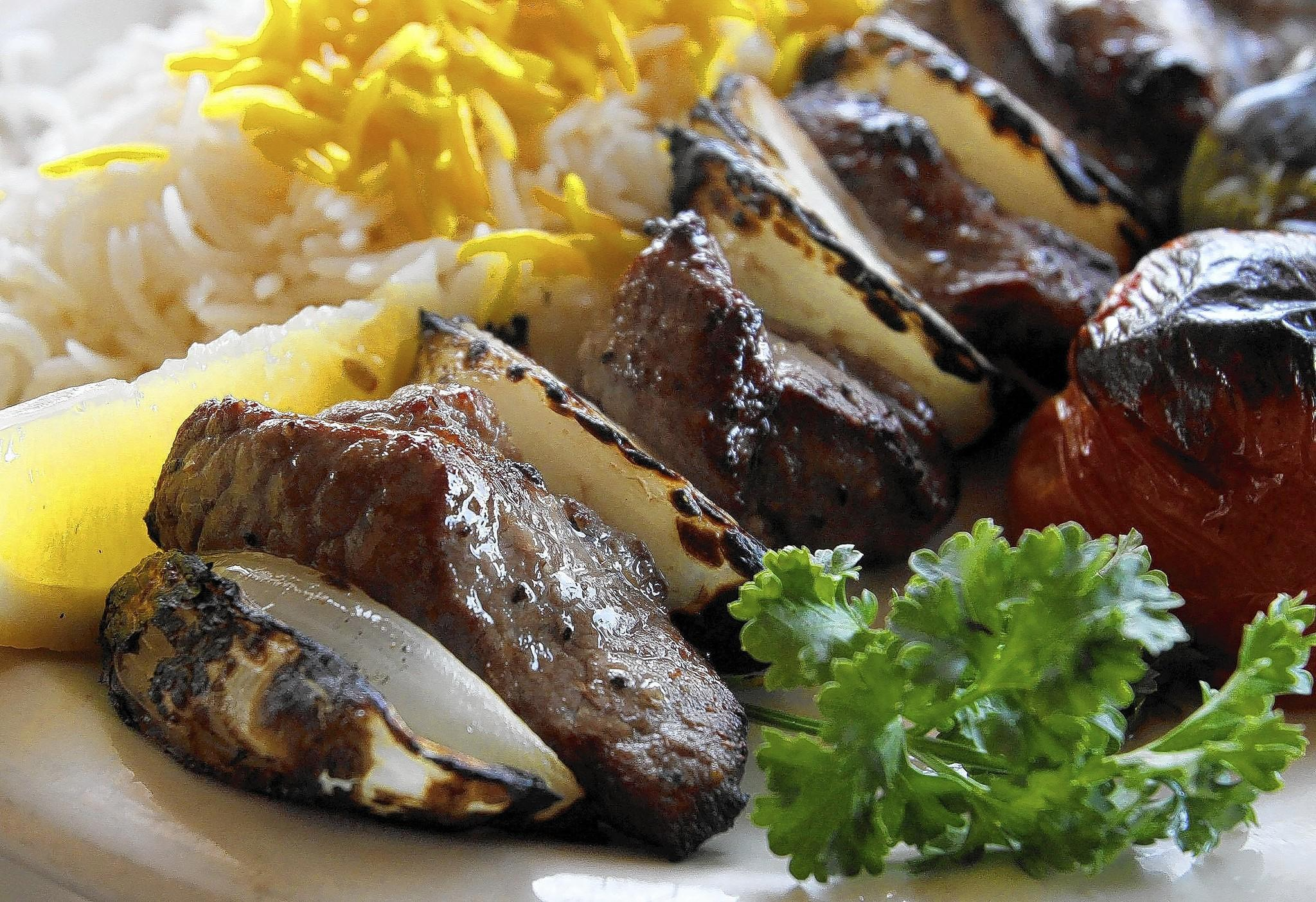 The lamb kabob comes with rice and grilled onions, tomato and pepper at The Olive Branch in the 3600 block of Foothill Boulevard in La Crescenta, on Thursday, Feb. 27, 2014.