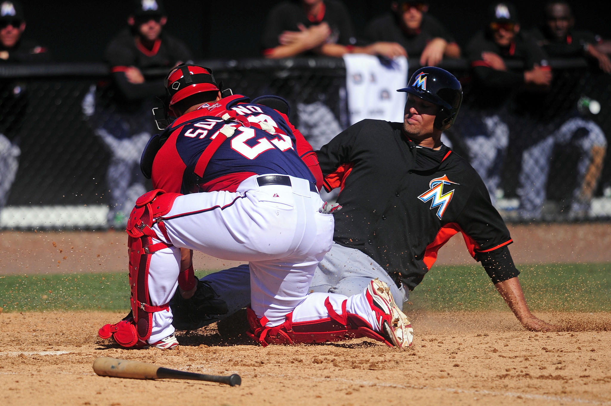 Miami Marlins left fielder Kyle Jensen (65) is tagged out by Washington Nationals catcher Jhonatan Solano (23) in the seventh inning as the Nationals beat the Marlins 10-3 in a spring training exhibition game at Space Coast Stadium Sunday.