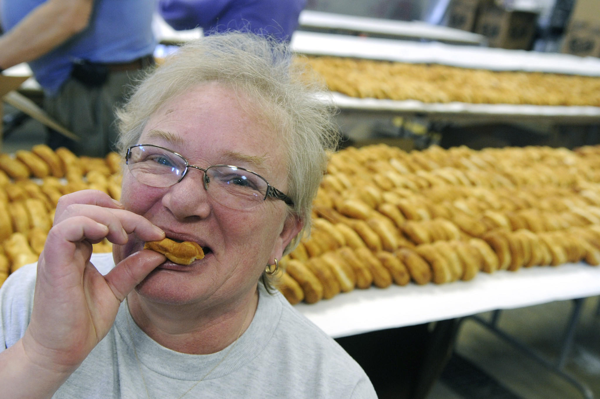 Linda Gorr of Breinigsville, president of Ladies Auxiliary at the Goodwill Fire Co., enjoys a fastnacht in the annual fastnacht-making event Saturday. Fastnachts might be available after orders are filled, call 610-395-9759 after Monday, Feb. 20 for availability. ////// TREXLERTOWN DONNA FISHER/THE MORNING CALL Pic made SATURDAY, FEBRUARY 18, 2012