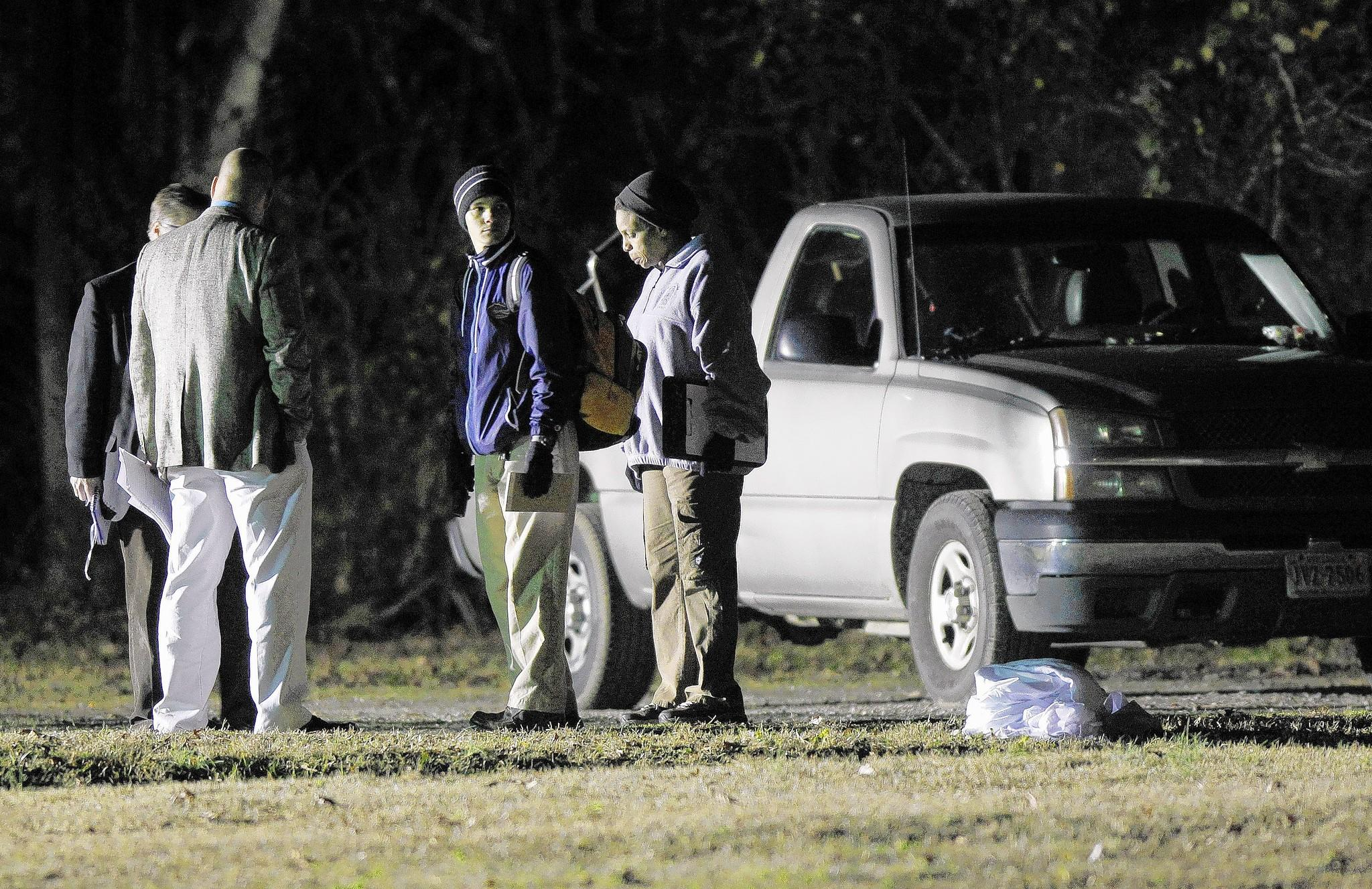 Officials investigate the scene of a shooting that occurred at Woodland Skate Park in Hampton just before 4 p.m. on Dec. 31. A 16-year-old has been charged with capital murder in the slayings.