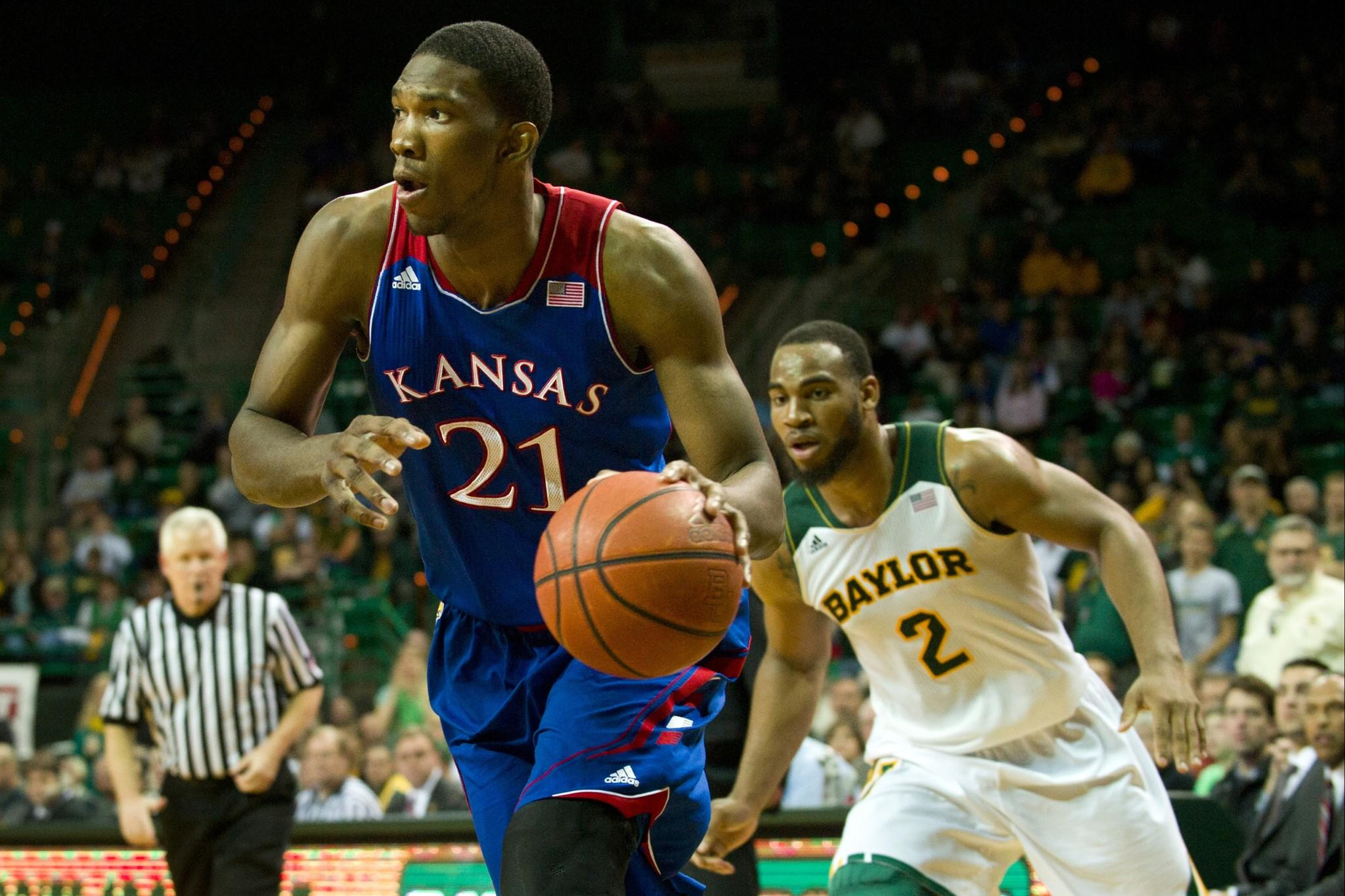 Joel Embiid of Kansas drives to the basket against Baylor.