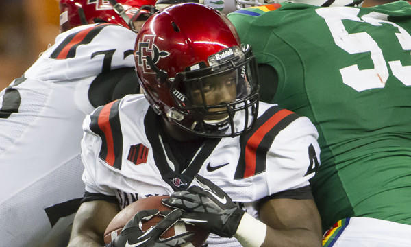 San Diego State running back Adam Muema carries the ball during a game against Hawaii in November. No decision has been made as to whether Muema will participate in the school's pro day on March 19.
