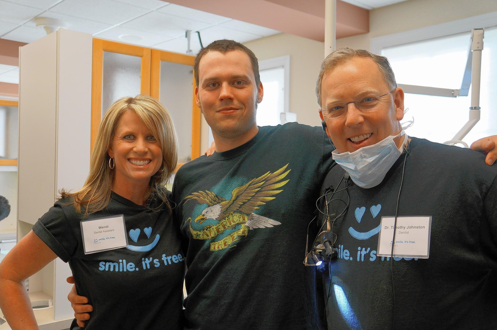 "Dentist Tim Johnston, right, with patient William Chamblee, who drove from North Carolina for the 2013 ""Dentistry from the Heart"" event, and dental assistant Wendi at Norge Dental Clinic."
