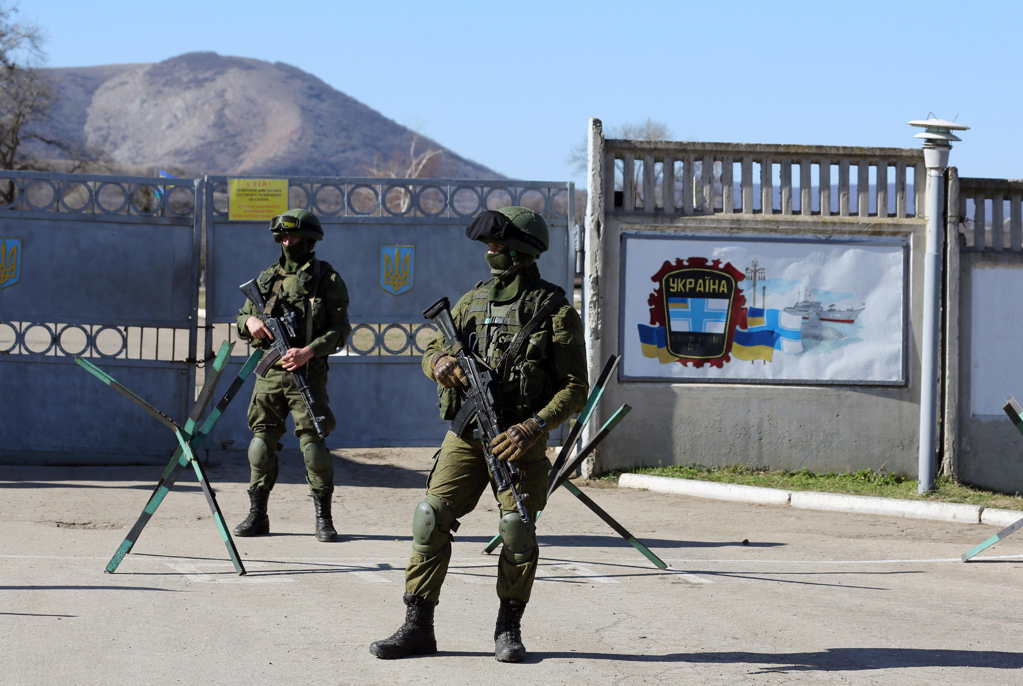 Russian soldiers stand guard in front of a Ukrainian military base in the Crimean peninsula.